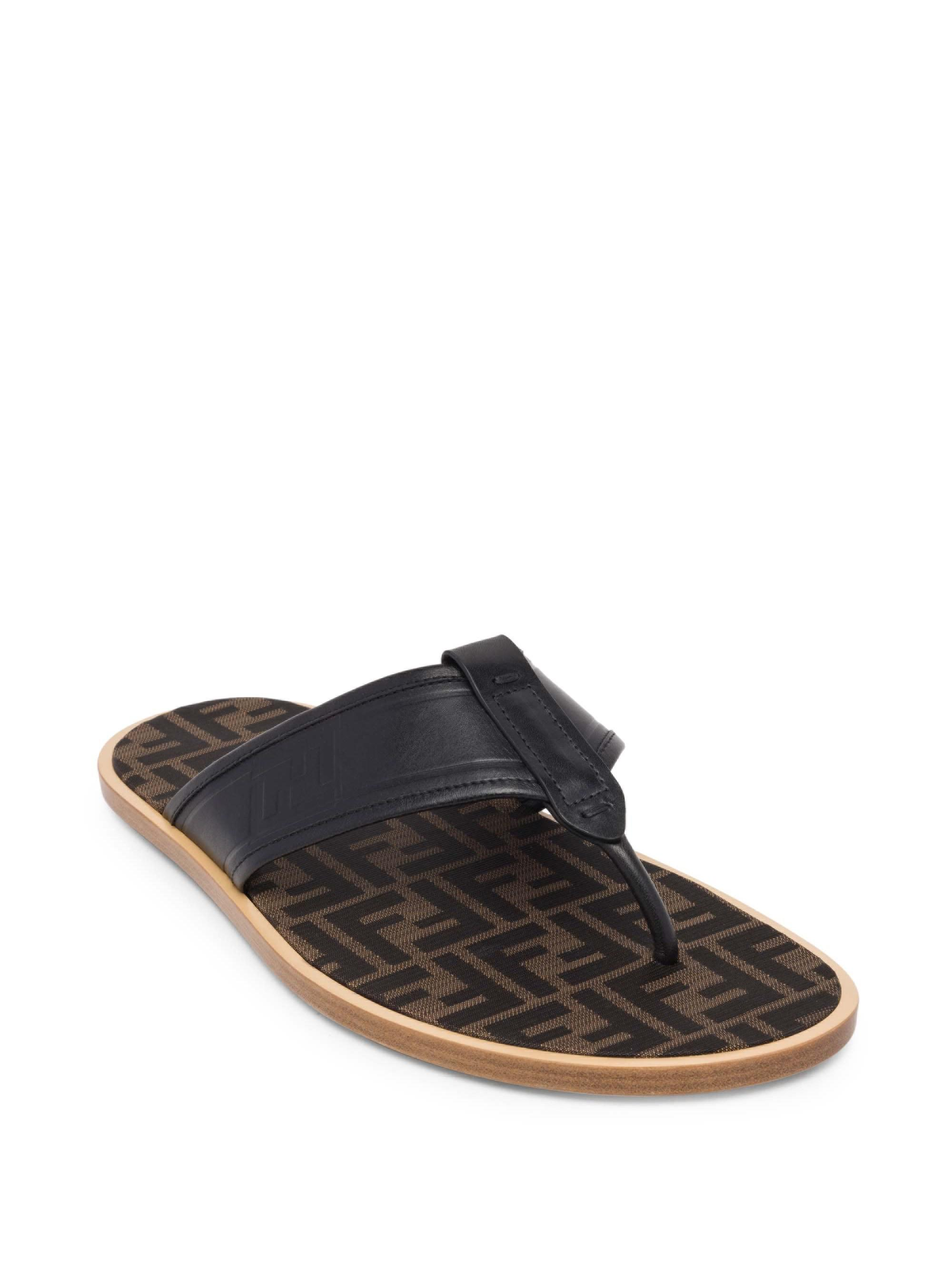 ad5a063a46c7be Fendi. Men s Black Ff Print Flip Flops.  920 From Saks Fifth Avenue
