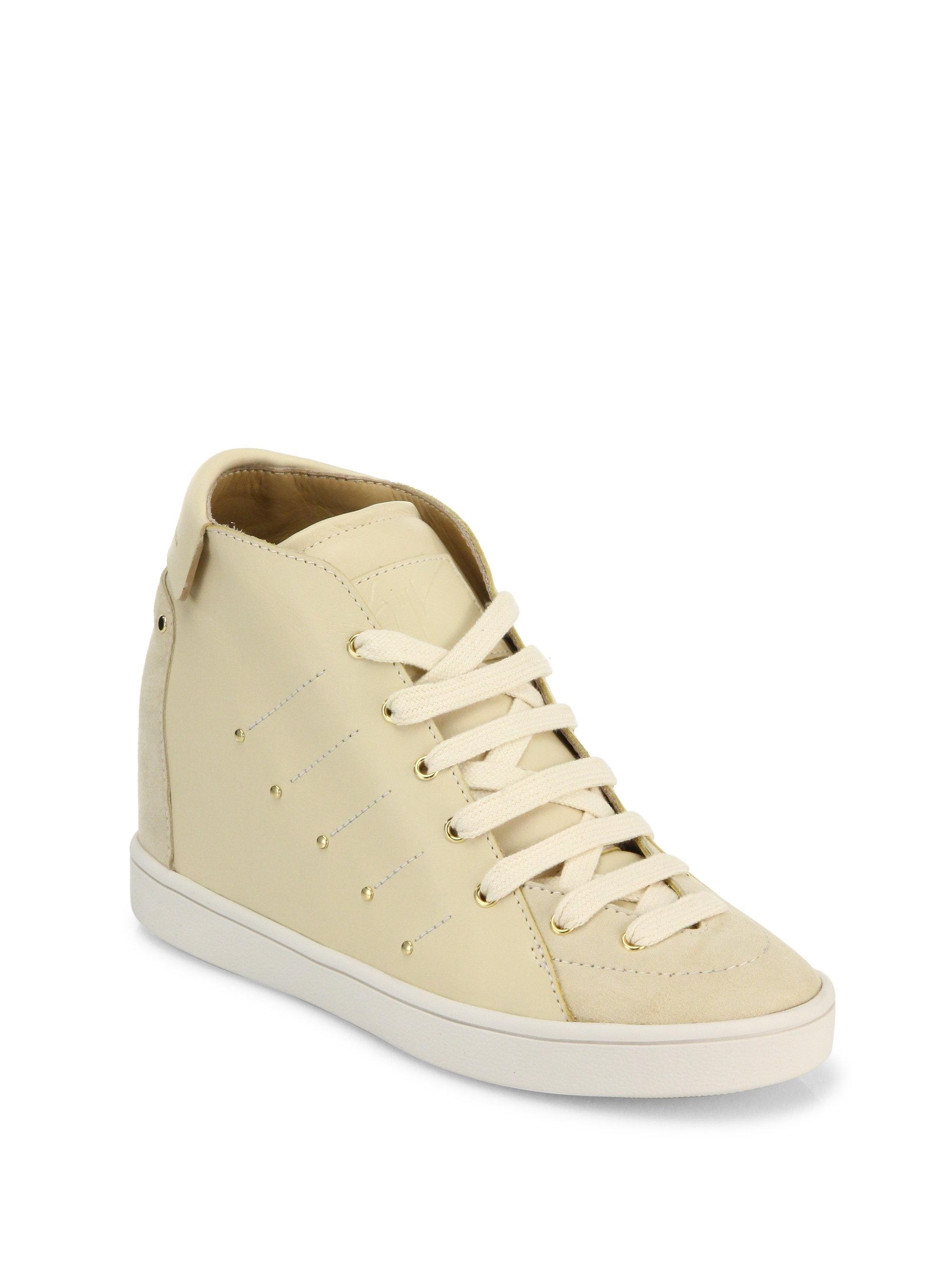 Gallery. Previously sold at: Saks Fifth Avenue · Women's Wedge Sneakers