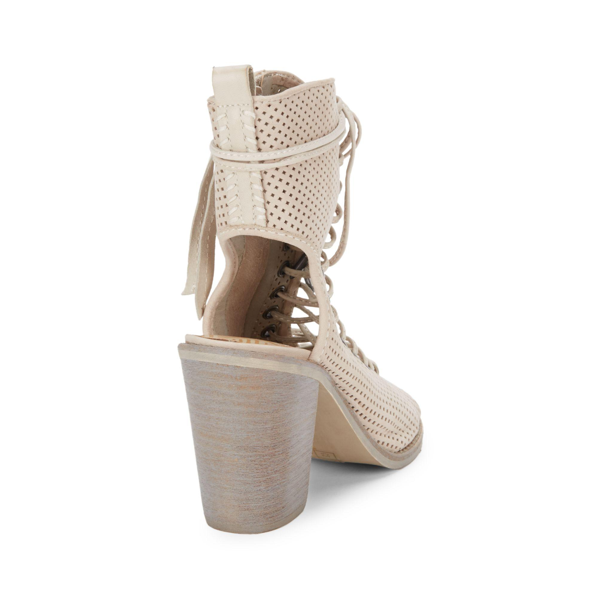 Dolce Vita Lira Sand Perforated Leather Ankle Boots in Black