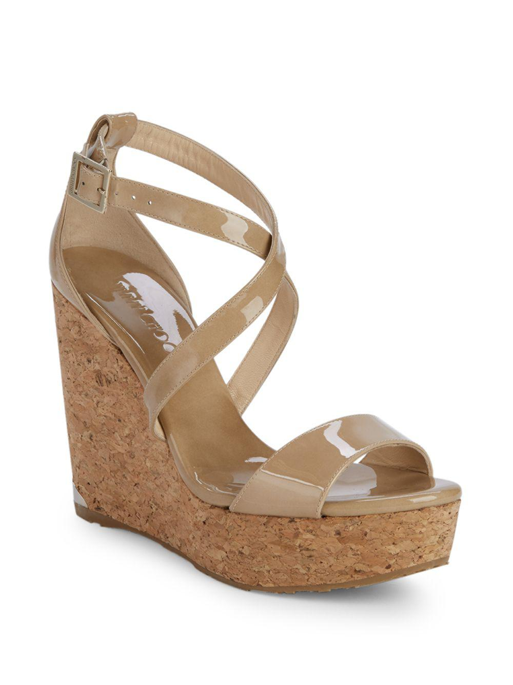 a98f9954be Lyst - Jimmy Choo Portia Patent Leather Wedge Sandals in Natural