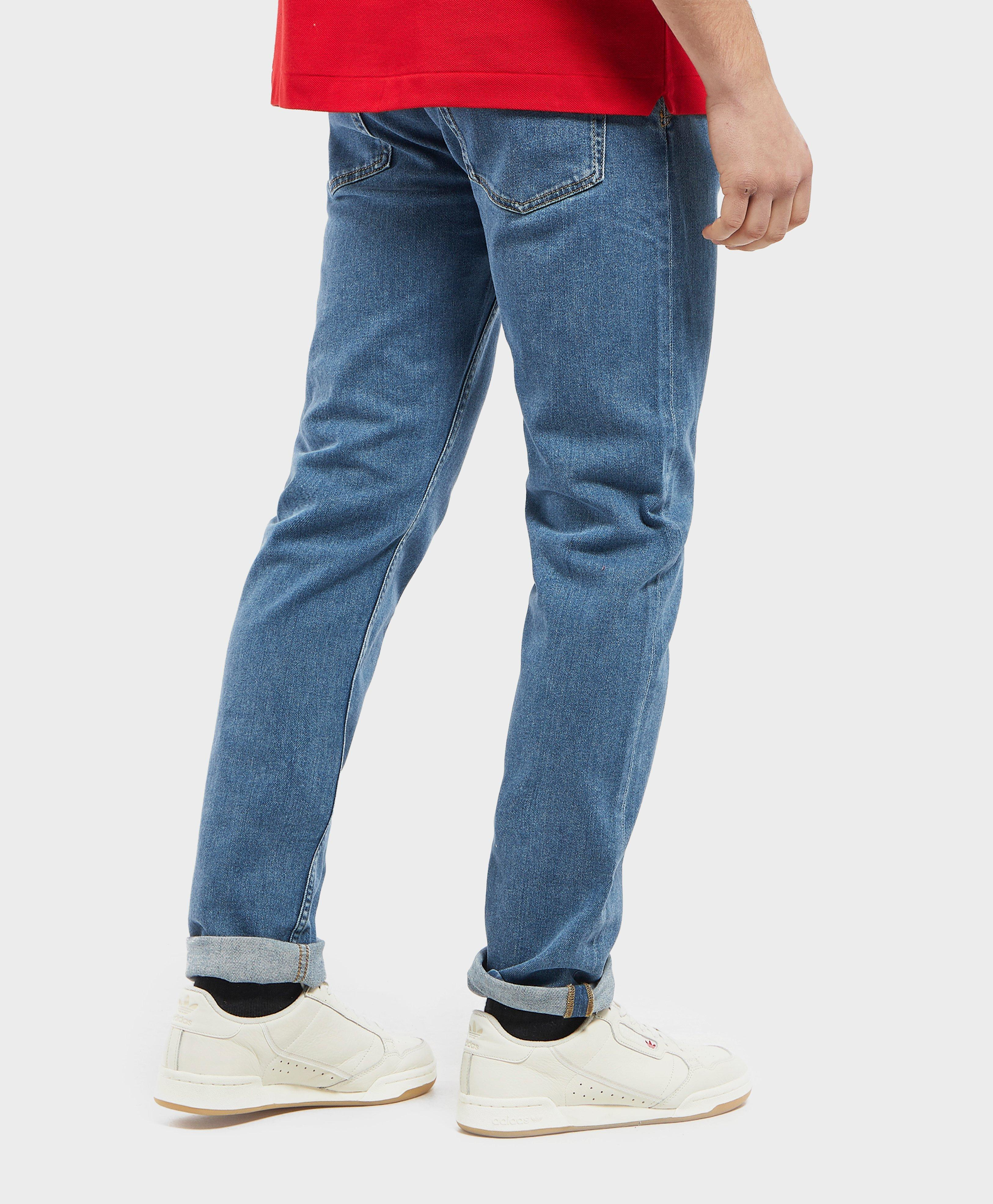 e179718a Lacoste Blue Slim Tapered Croc Jeans for men