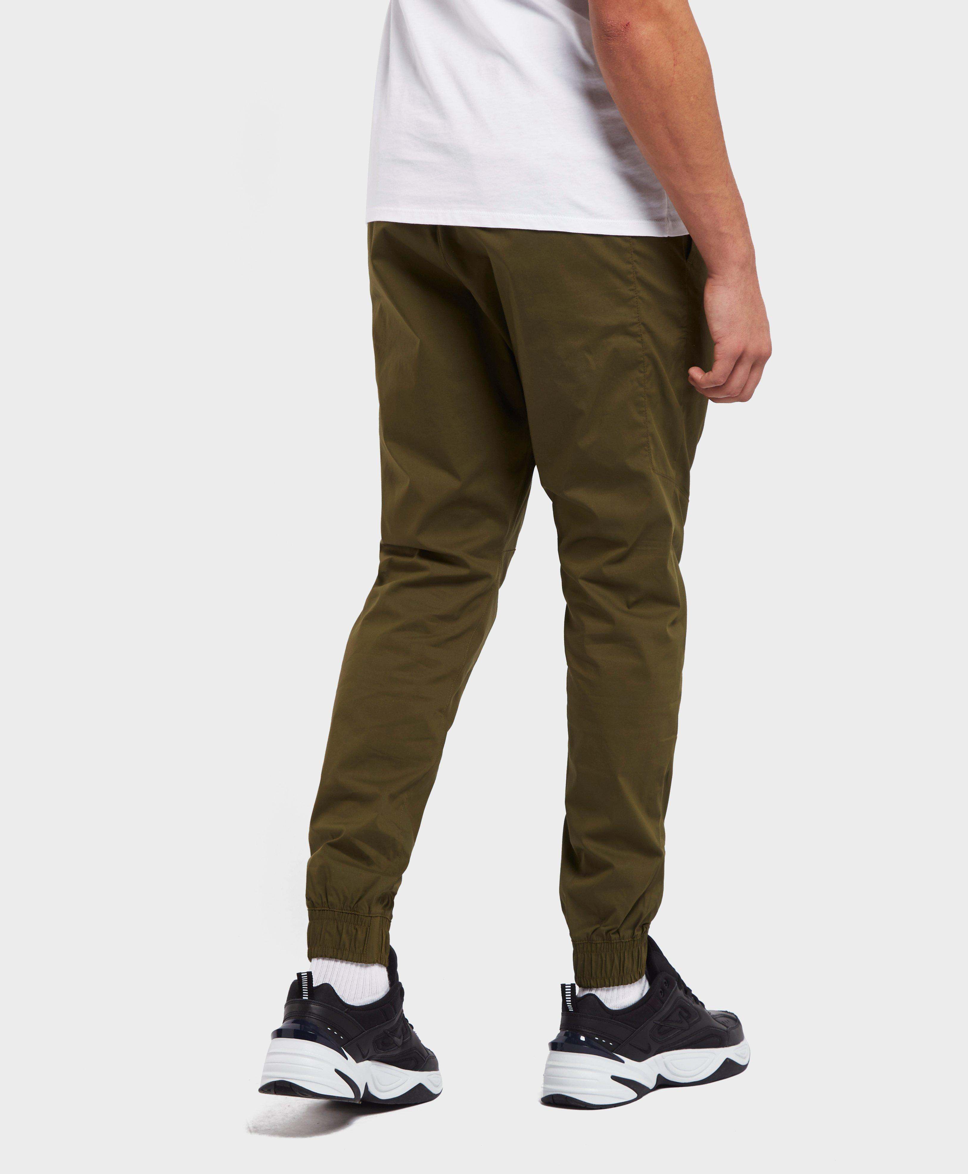 Lyst - Nike Twill Cuffed Track Pants in Green for Men 3277aebe4f46