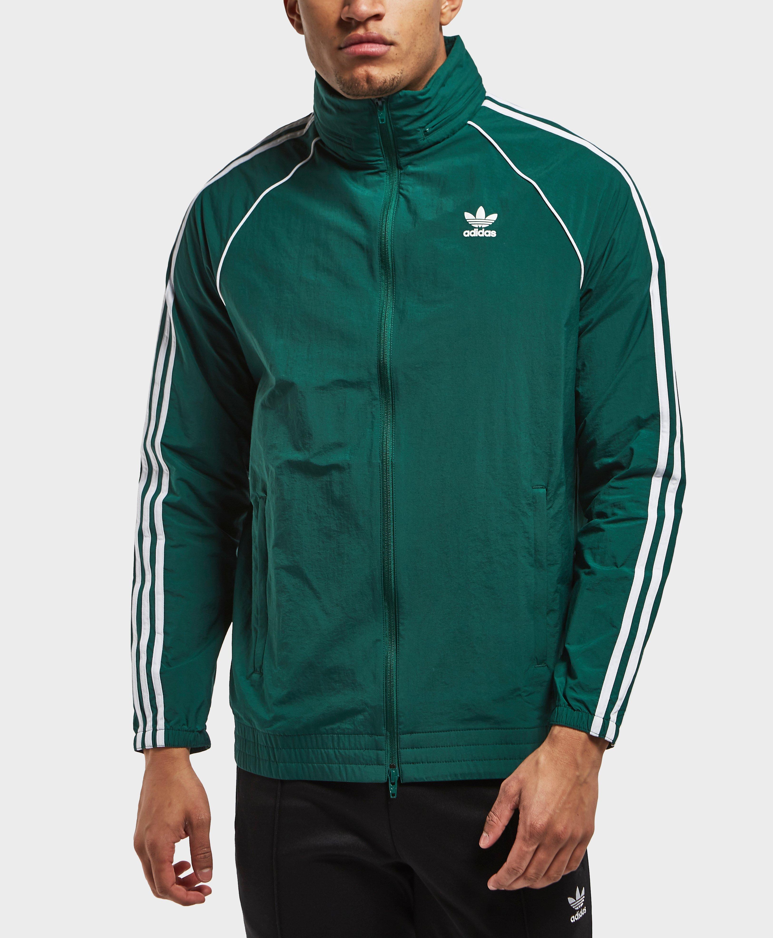 Adidas Originals Superstar rompevientos en verde para hombres Lyst