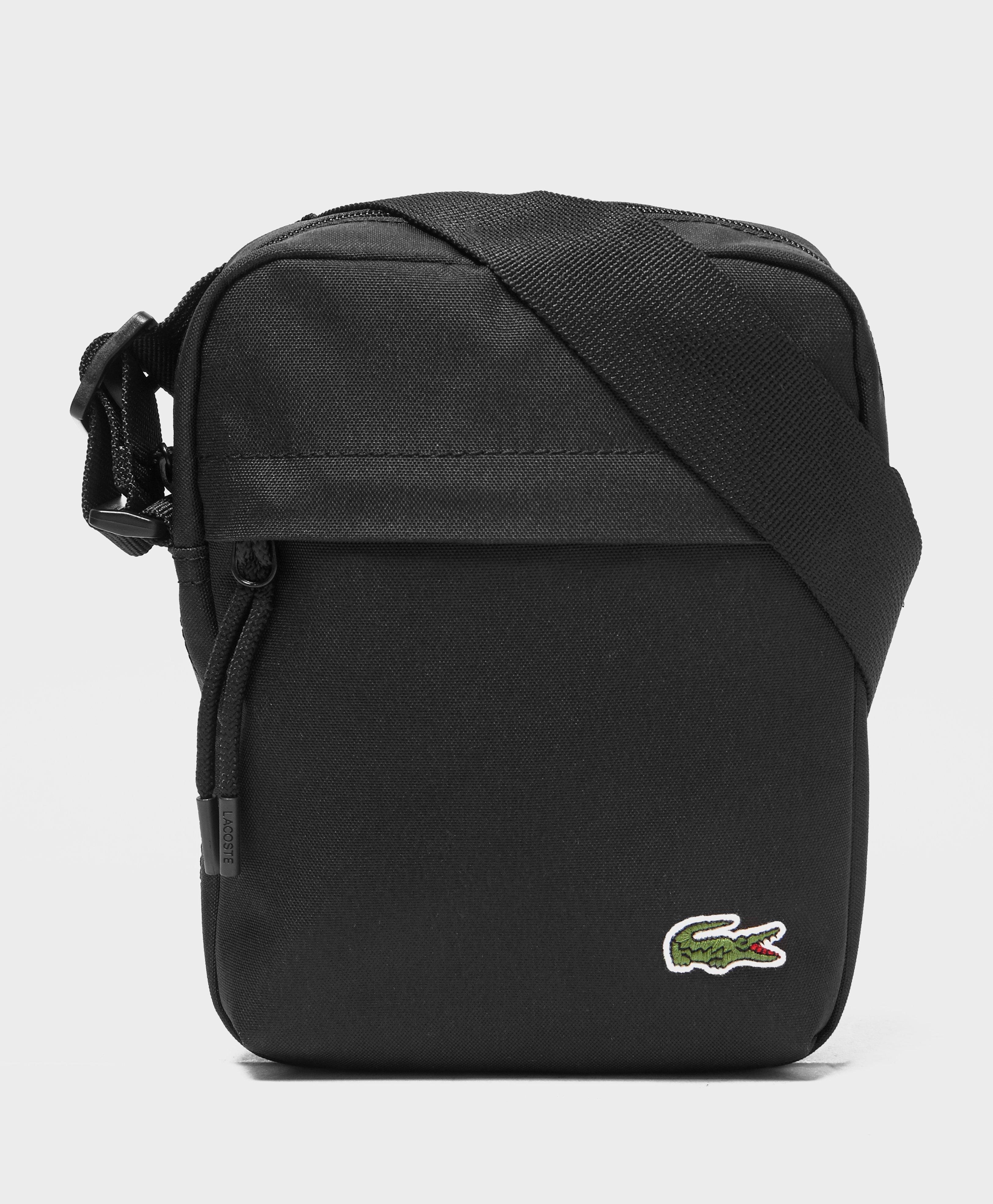 a57dfbb471 Lacoste Mini Bag in Black for Men - Lyst