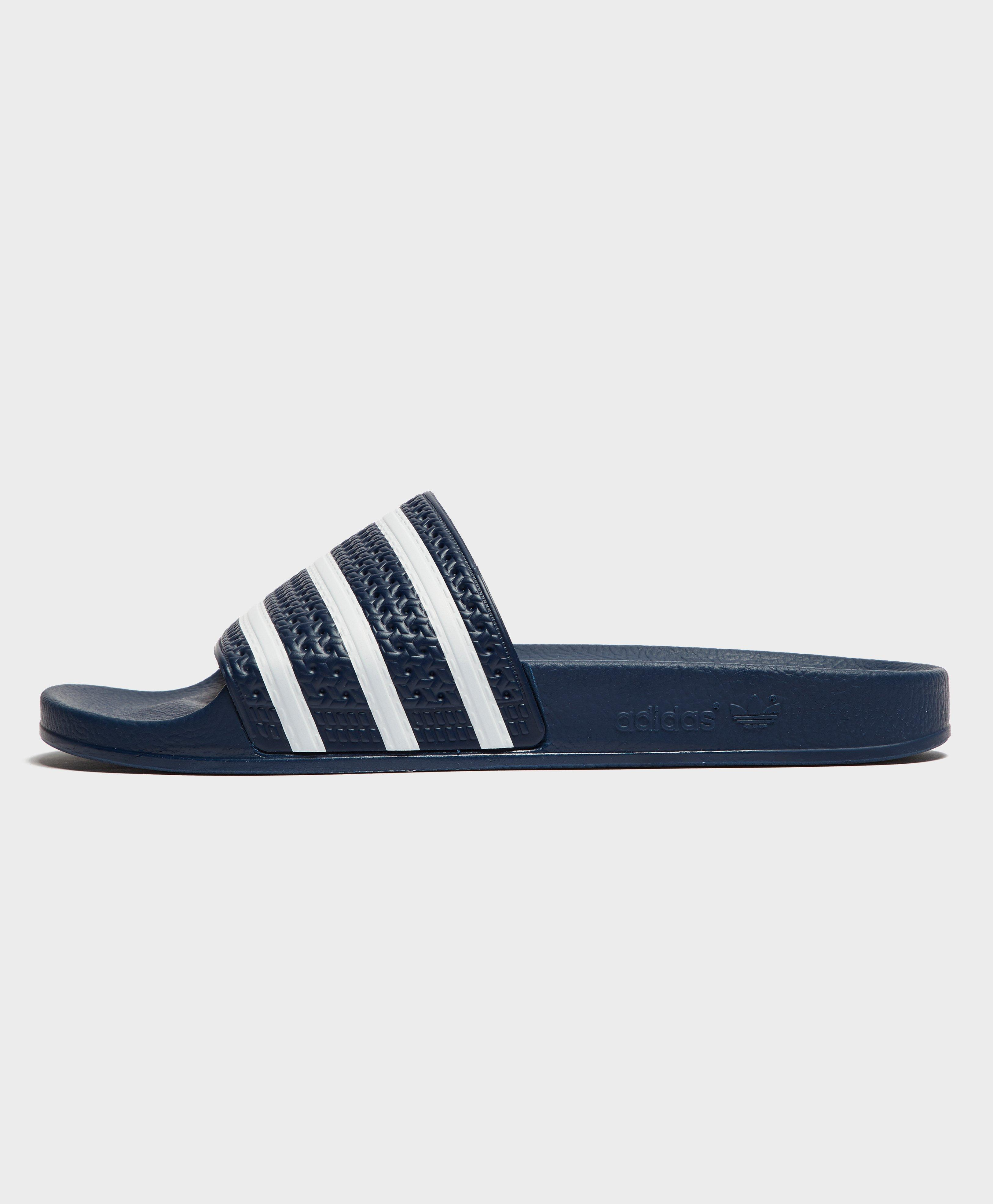4c4f989f00e471 adidas Originals Adilette Slides in Blue for Men - Lyst