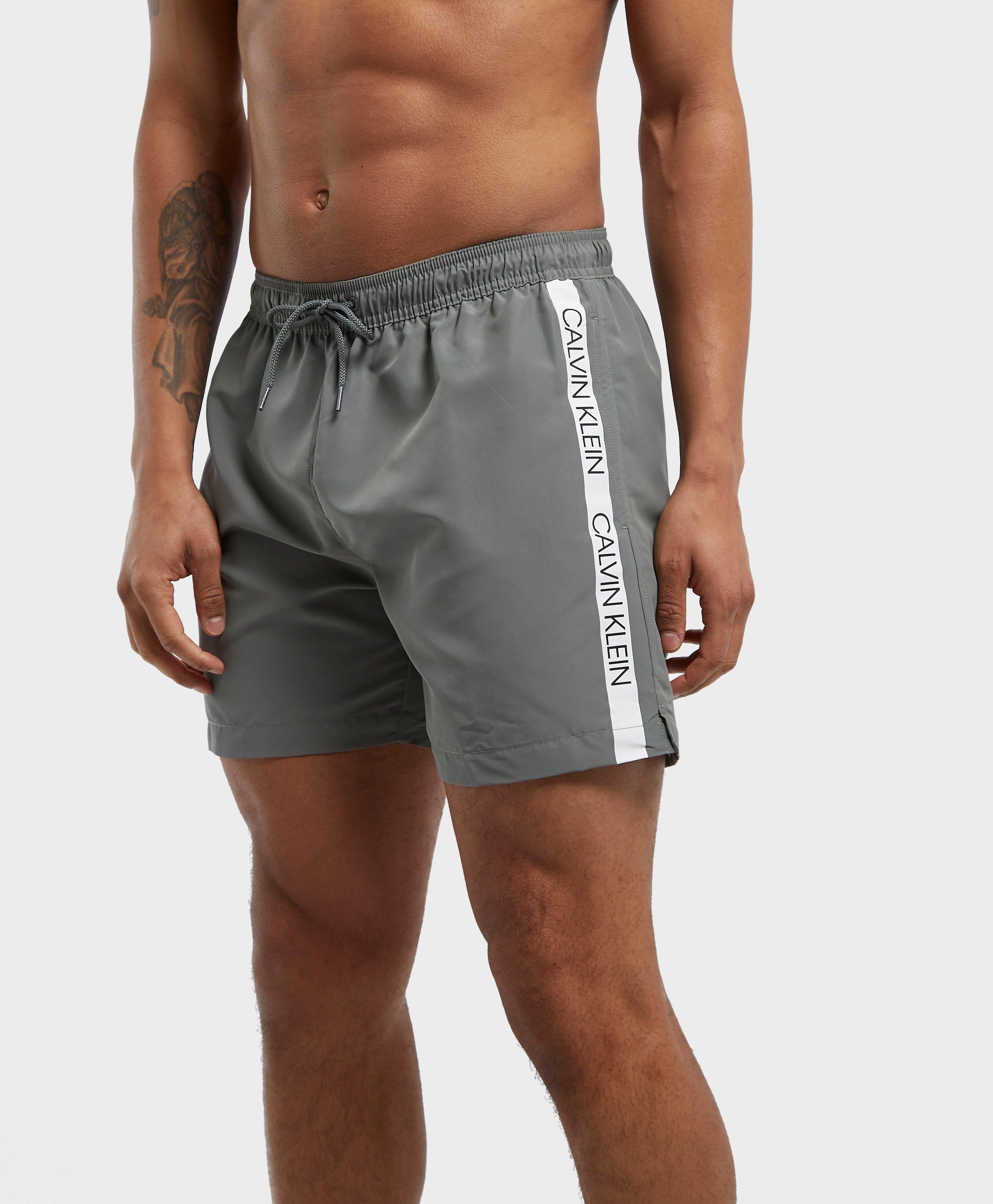 c614a3f2e7 Calvin Klein - Multicolor Tape Swim Shorts for Men - Lyst. View fullscreen