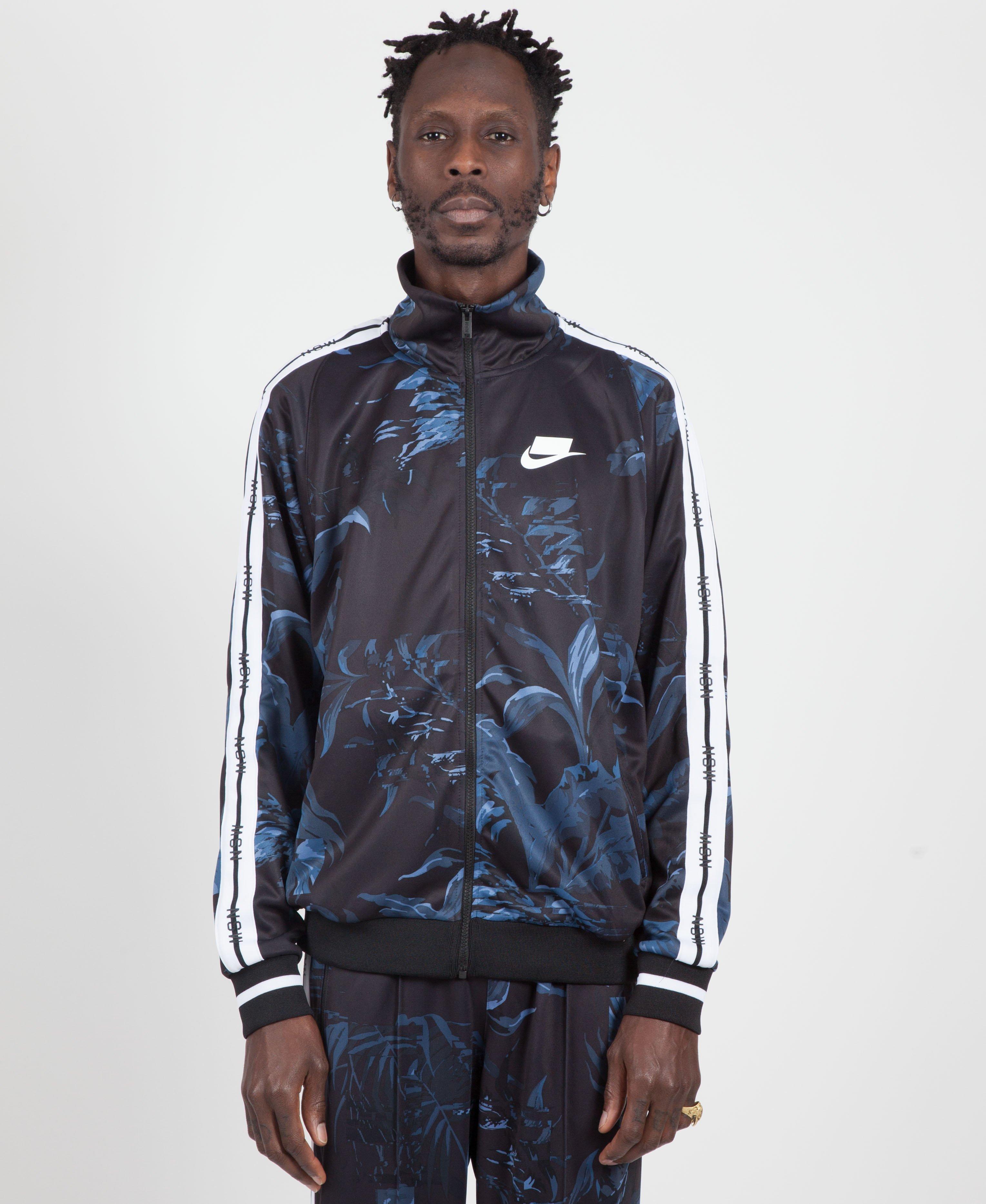 bf0ef9110fb3 Lyst - Nike Black dark Obsidian white Floral Nsw Tape Track Jacket ...