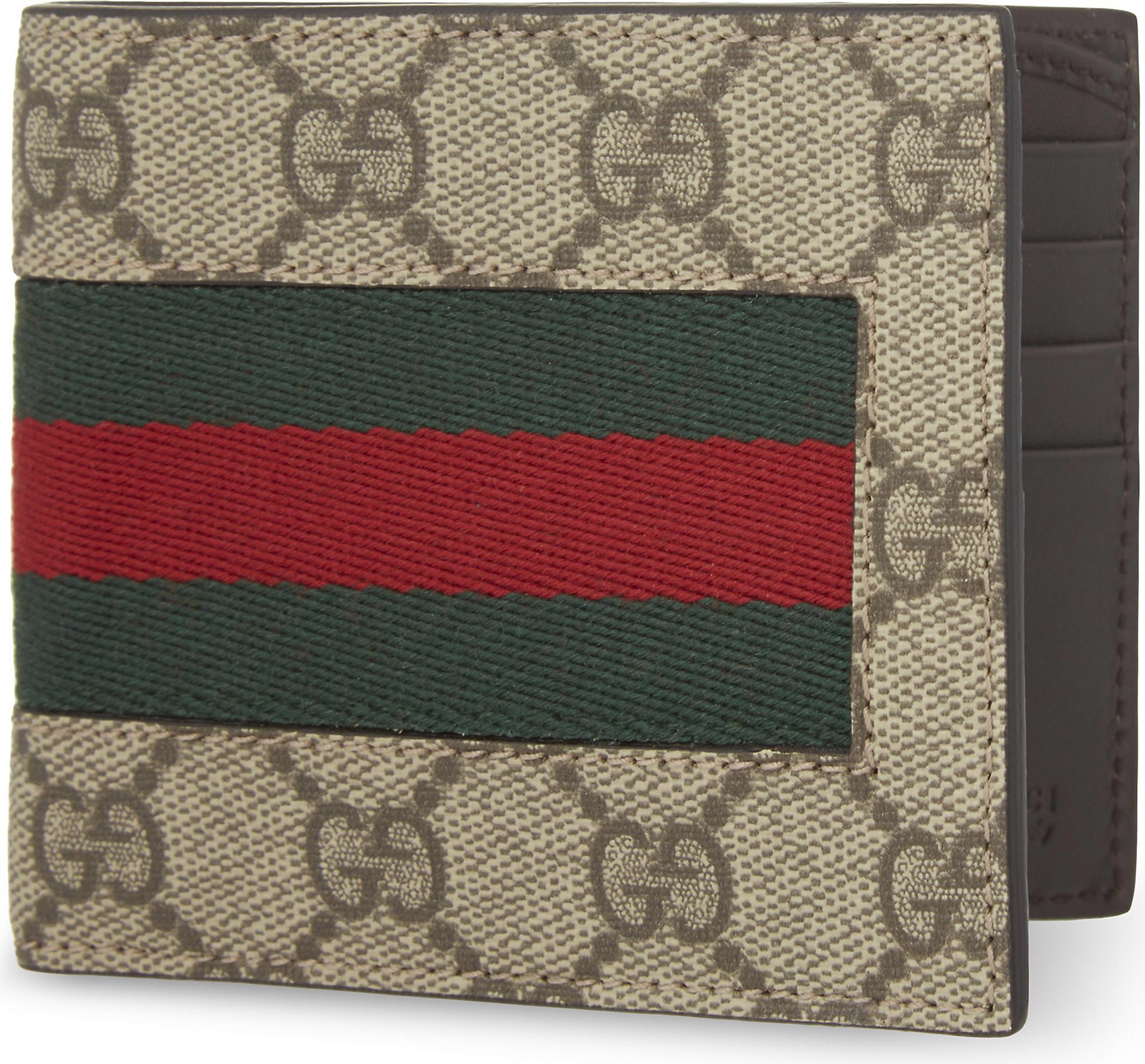 65b6c3bb Gucci Green Web GG Supreme Billfold Wallet for men
