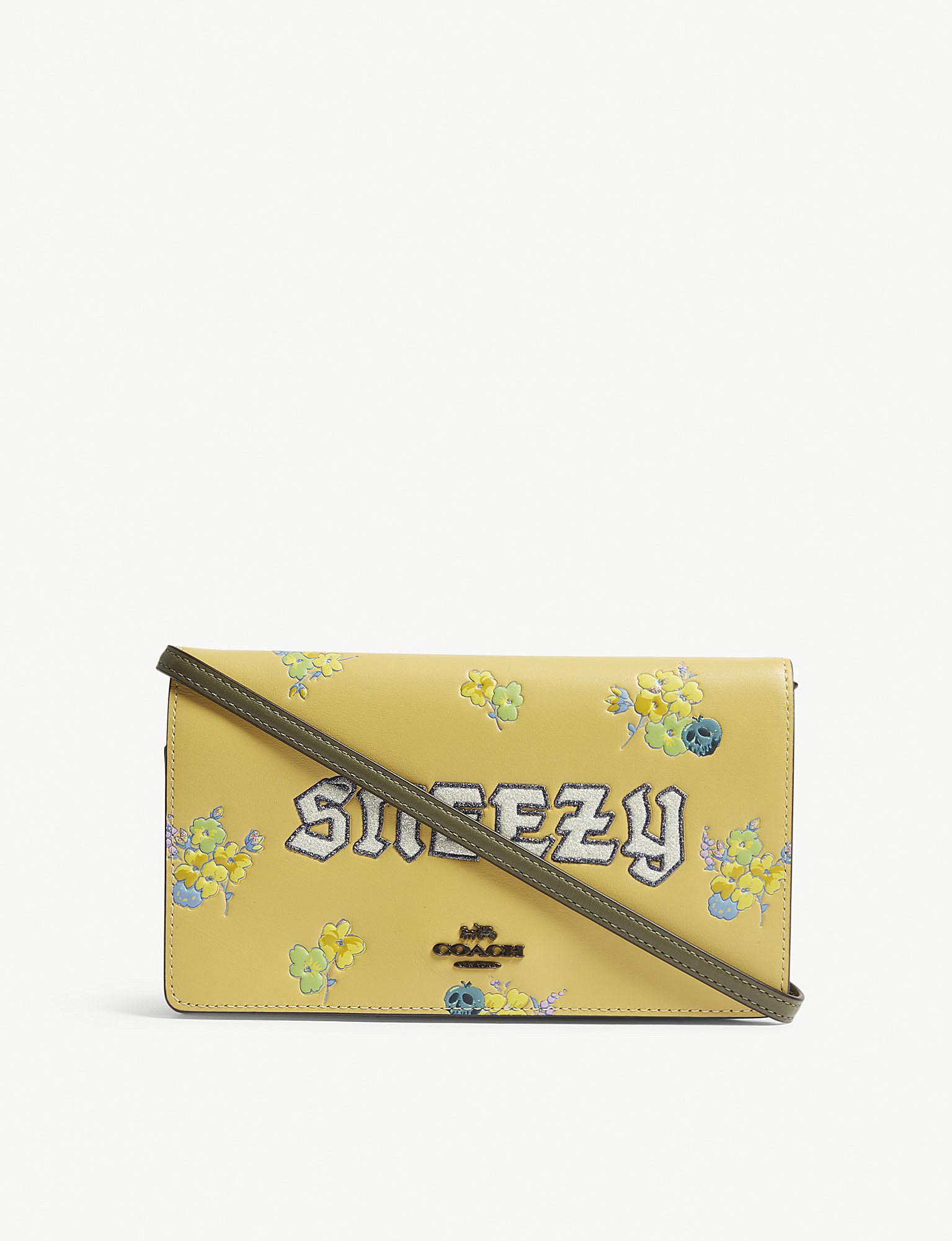 7f00402eed28 COACH. Women s Ladies Yellow Floral Dark Disney Sneezy Leather Cross-body  Bag