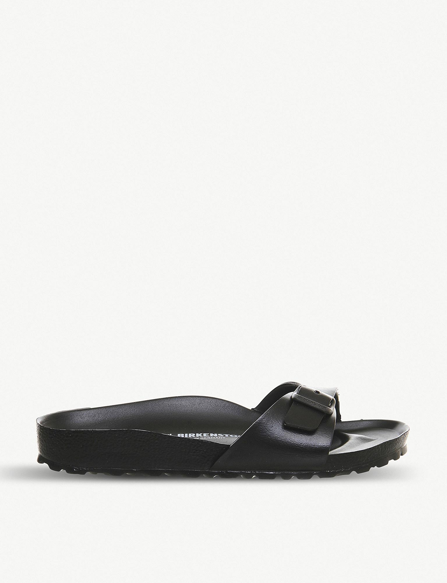 1a3fb4180a8 Lyst - Birkenstock Madrid 1 Bar Faux-leather Sandals in Black