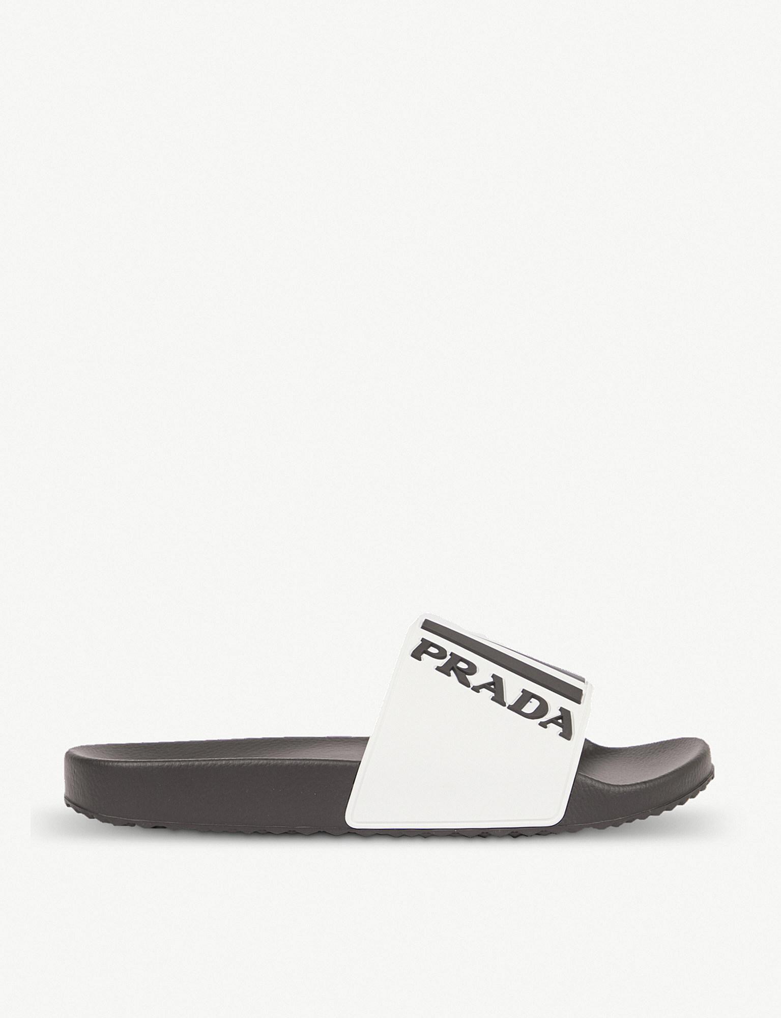 45c437d9d7be4f Lyst - Prada Logo Rubber Sliders in White