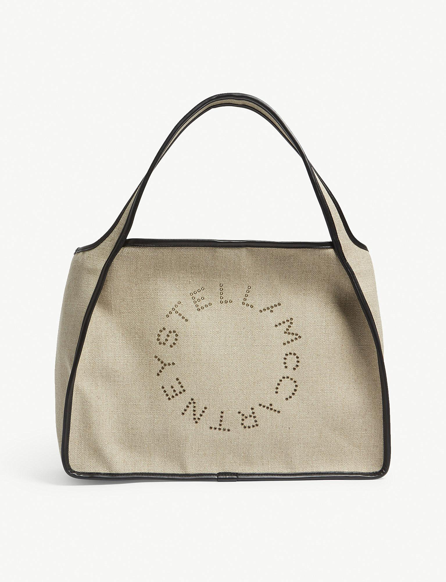 Stella McCartney Stella logo grommet-embellished tote Professional Online Largest Supplier Sale Online Sale For Nice 3bPC4qft