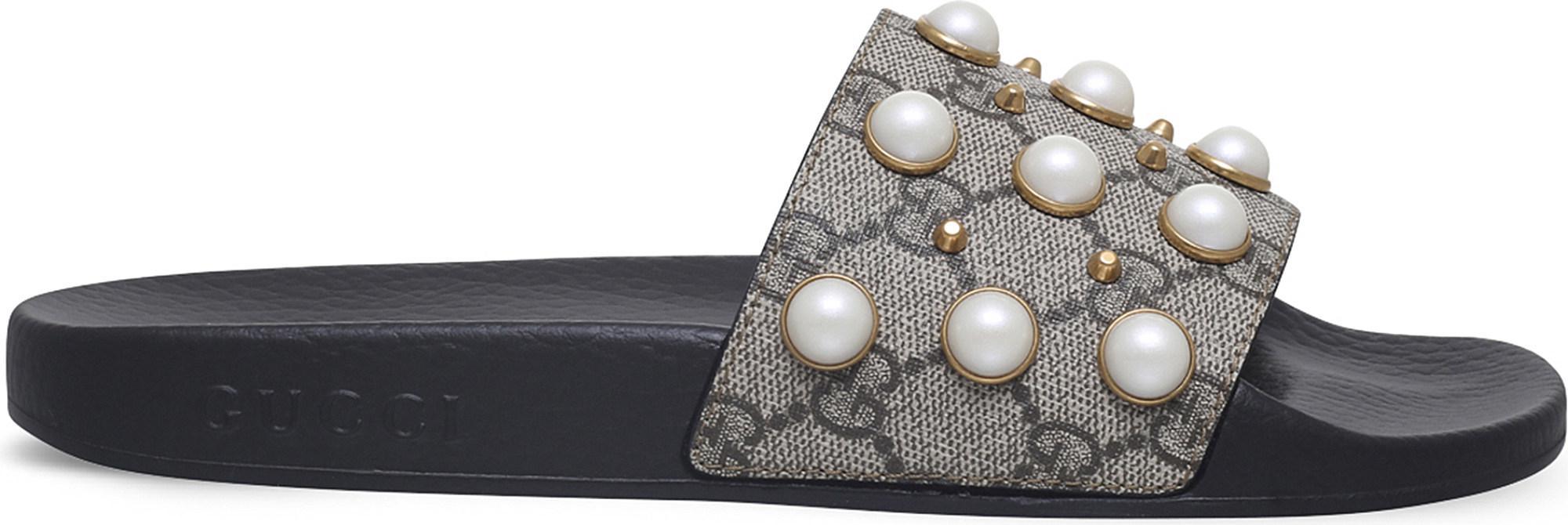 724c46cfa48 Gucci. Women s Pursuit Pearl-embellished Rubber Slider Sandals
