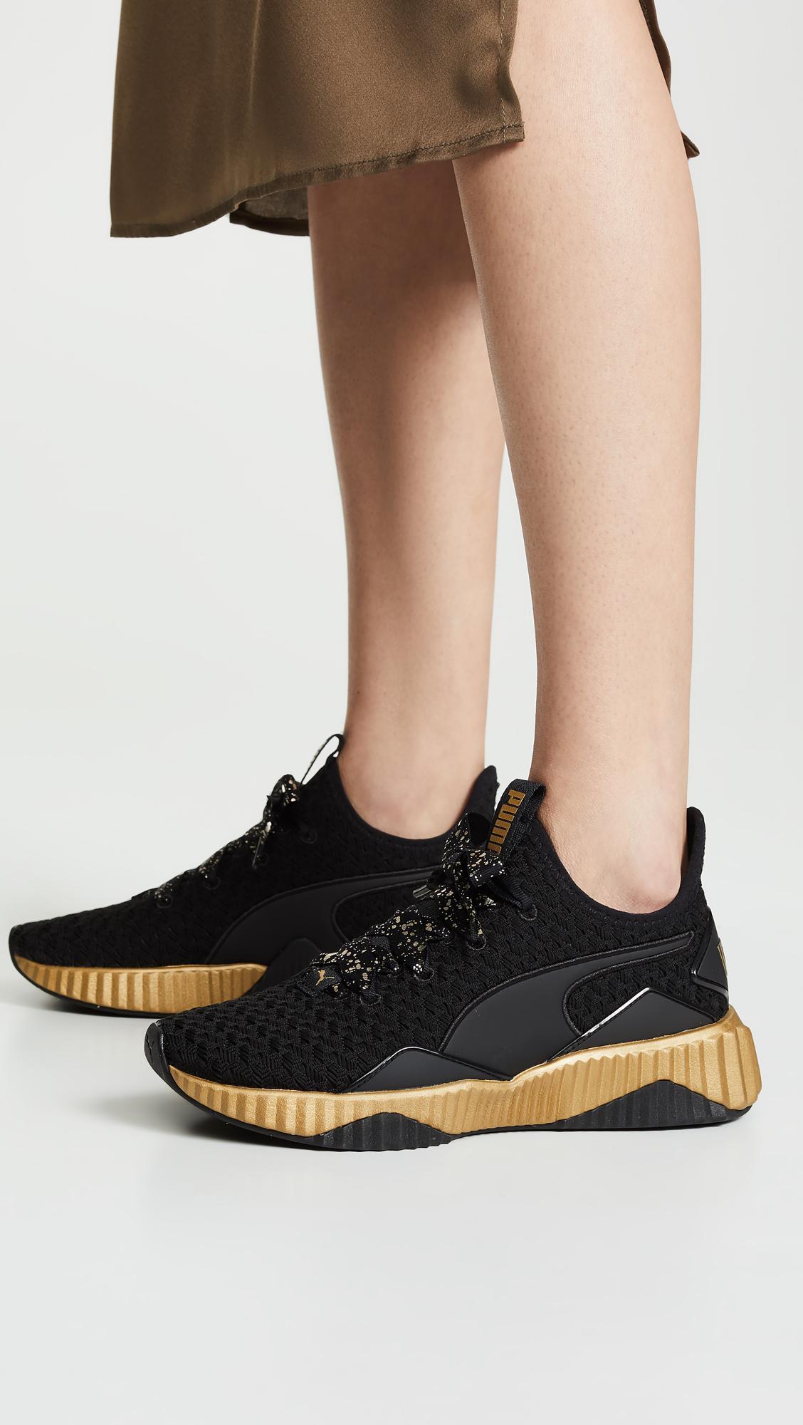 PUMA Defy Sparkle Sneakers in Black - Lyst