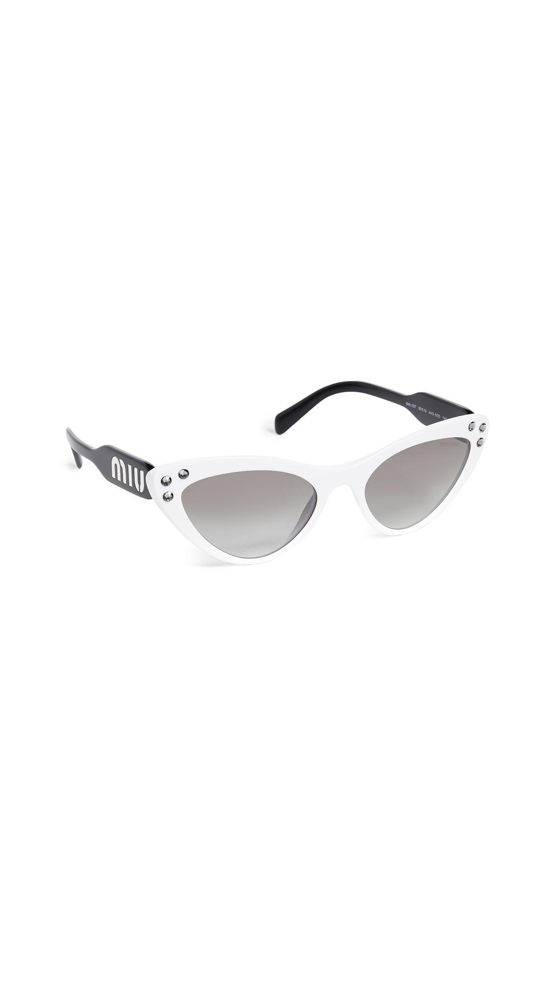 2c98f2ce53b Lyst - Miu Miu Crystals Cat Eye Sunglasses
