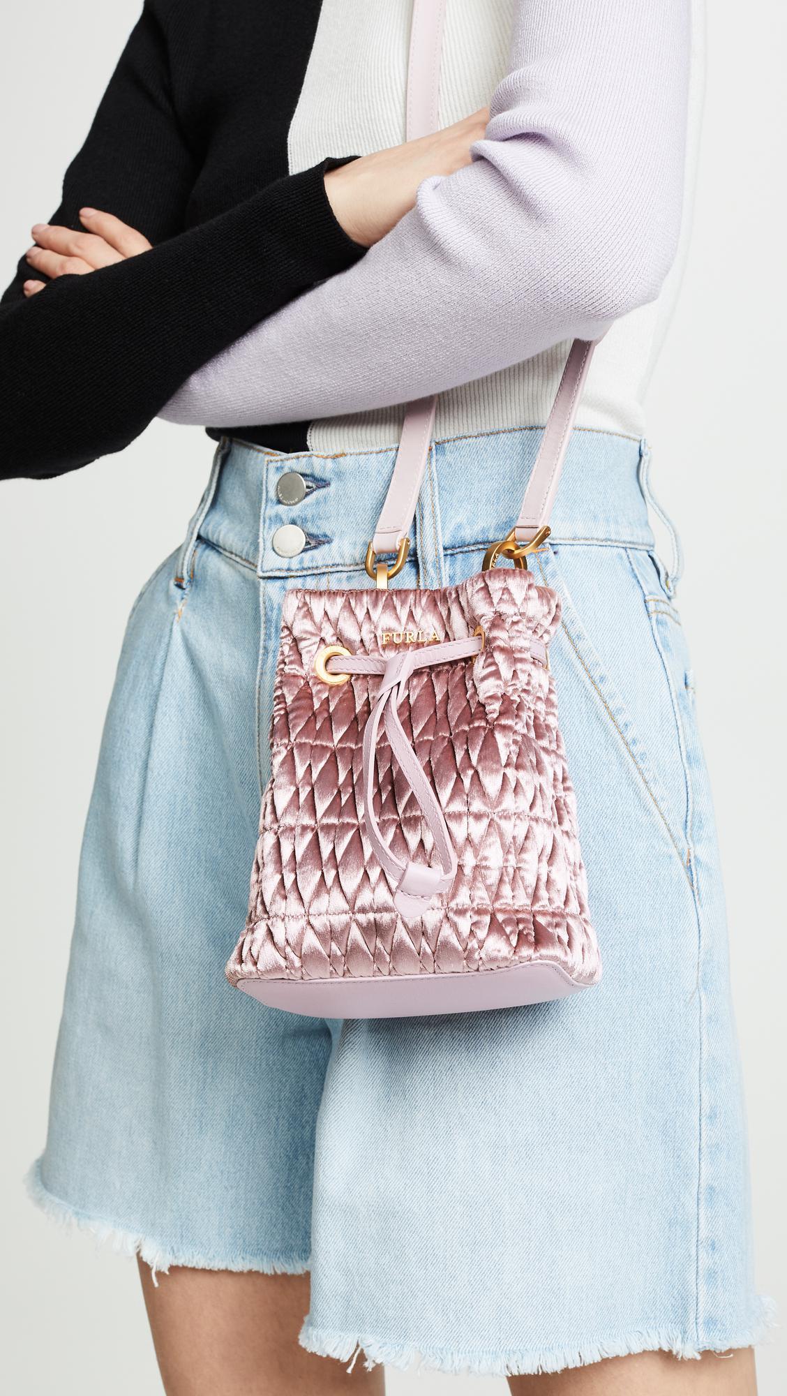 4a33614c839f ... Mini Drawstring Bag - Lyst. View fullscreen