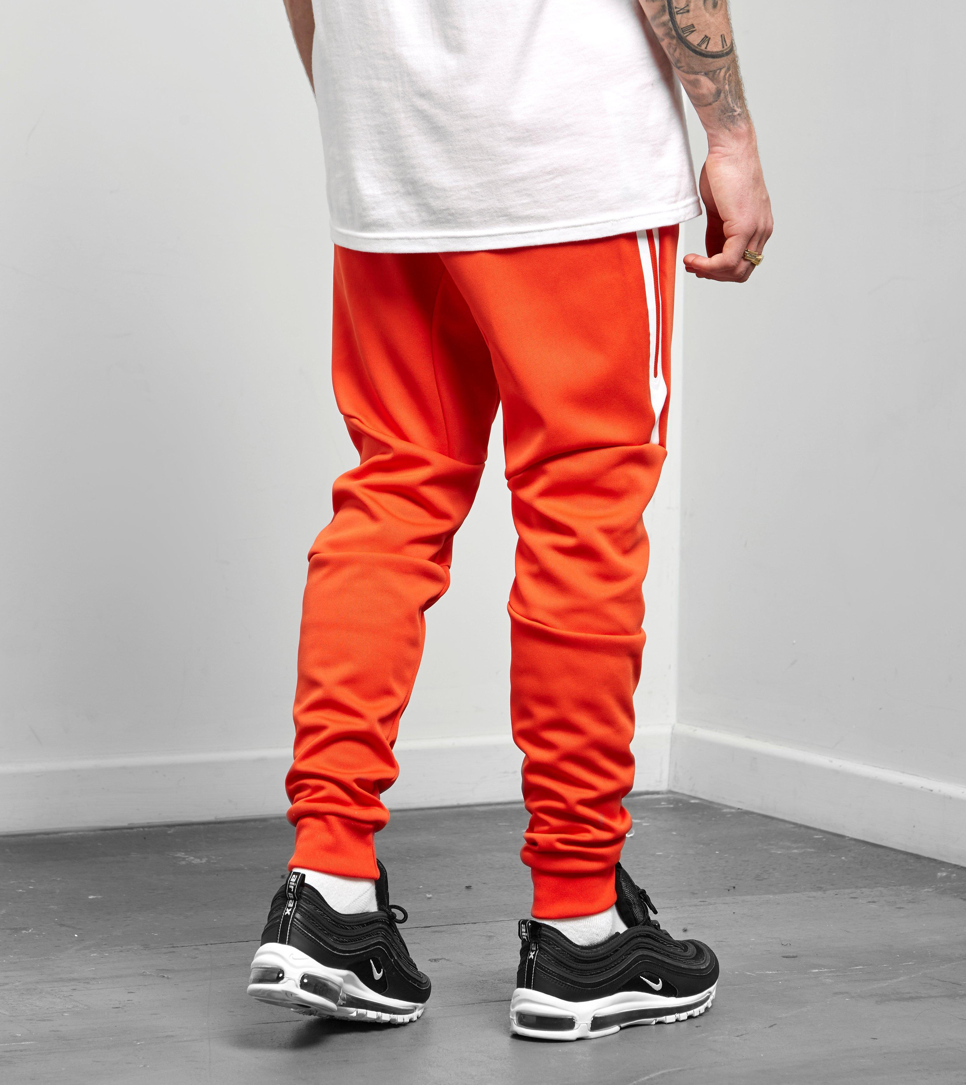 06ec1ee48936 Lyst - Nike Tech Icon Jogger in Orange for Men