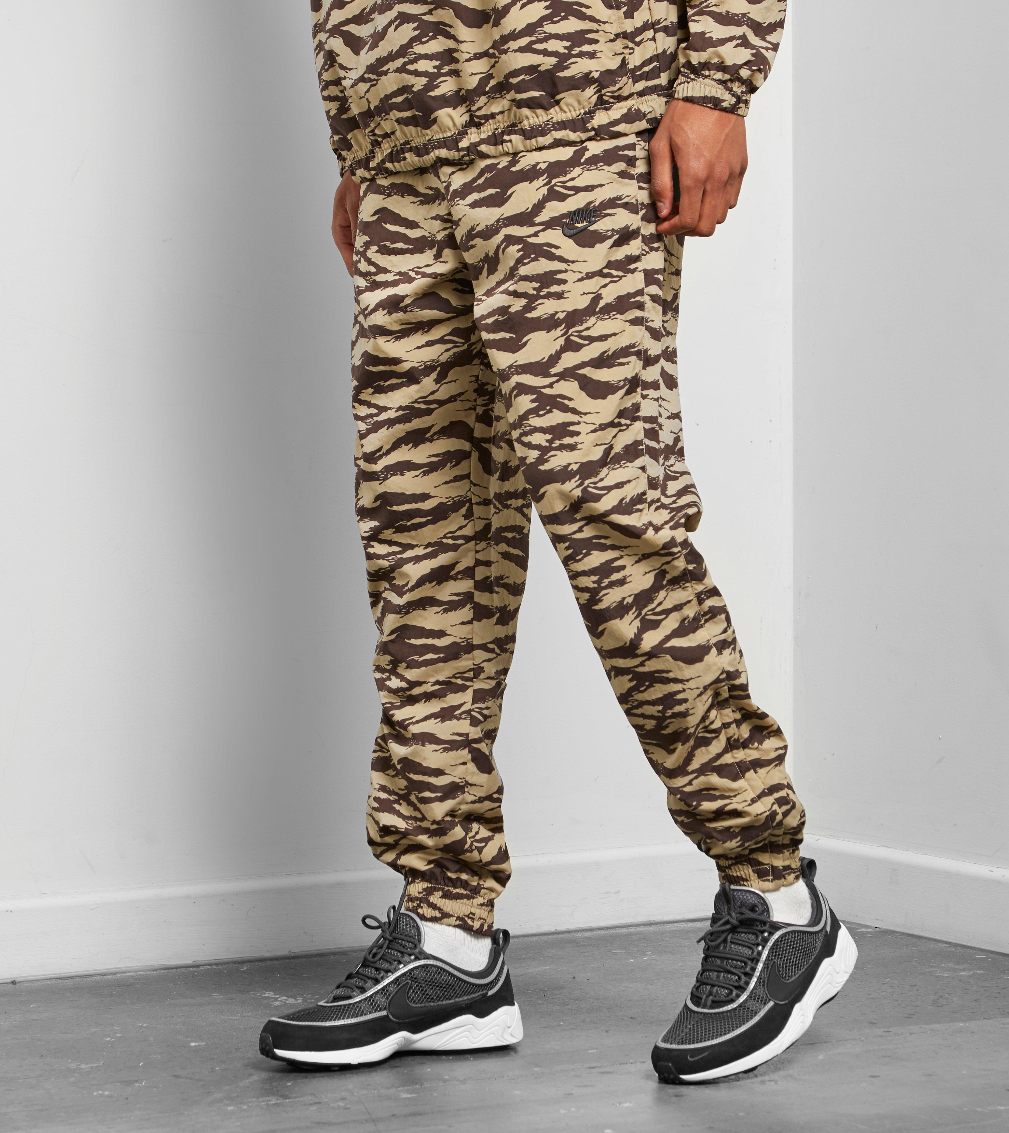 ef2afe43 Nike Swoosh Woven Pants for Men - Lyst