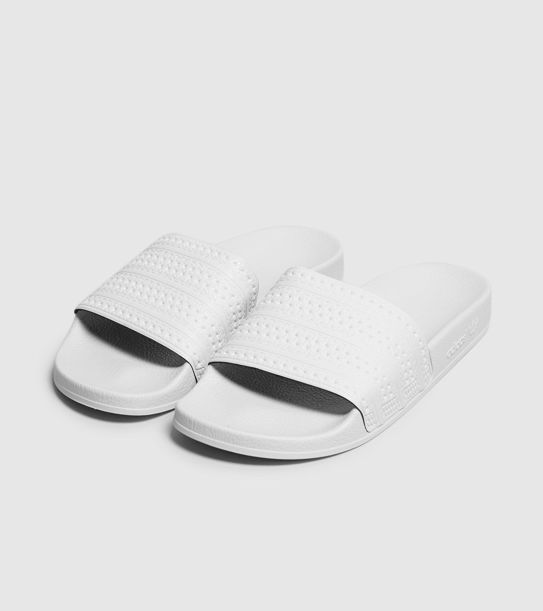 Lyst - adidas Originals Adilette Slides for Men 08b2d150f