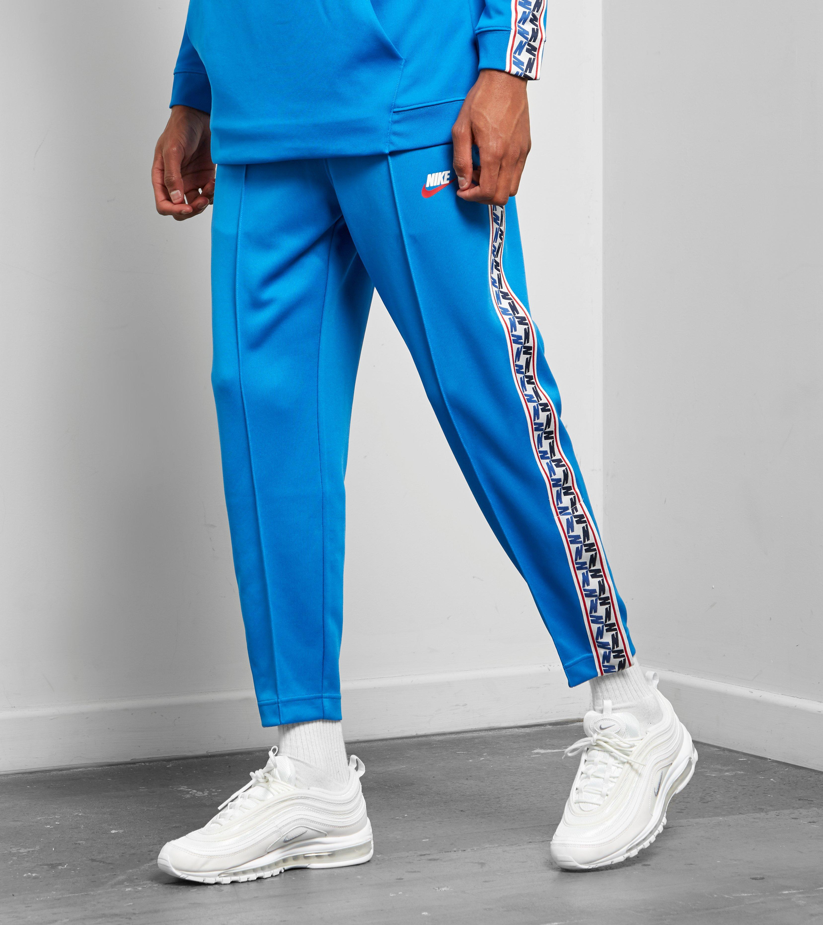 1630265d0b1a Lyst - Nike Taped Poly Track Pants in Blue for Men