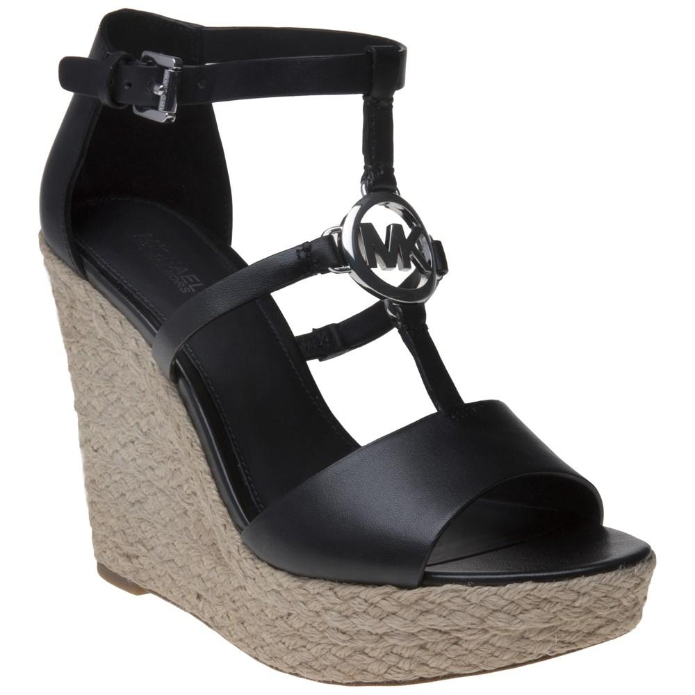 8f28a40679b1 Michael Kors Beth Wedge Sandals in Black - Lyst