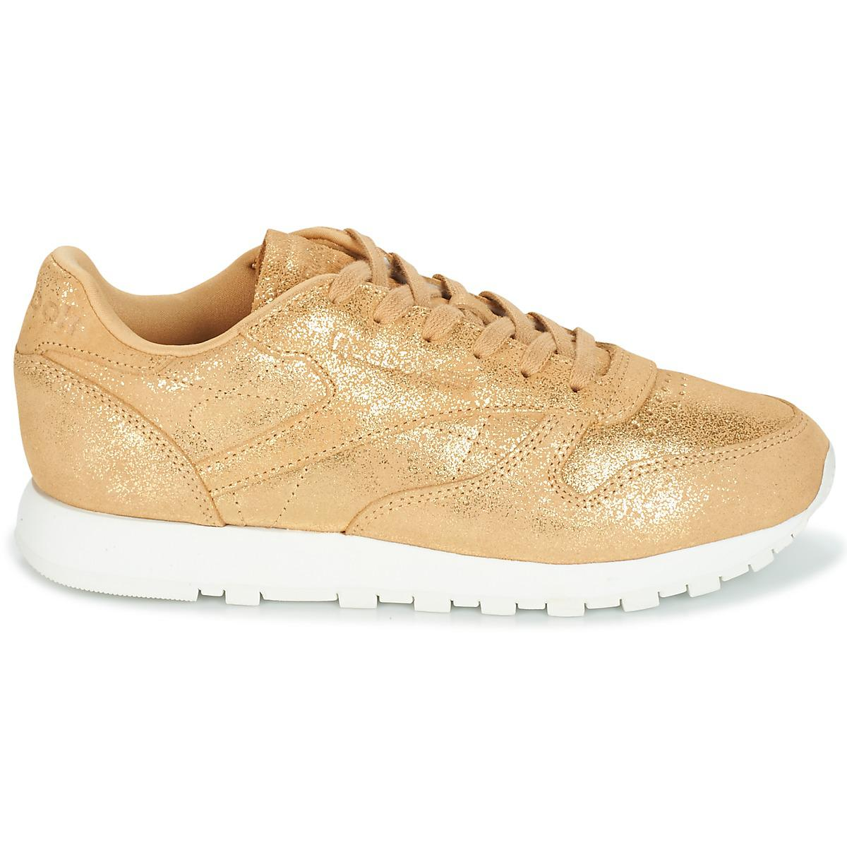 632964817c5c7 Reebok - Metallic Classic Leather Shimmer Women s Shoes (trainers) In Gold  - Lyst. View fullscreen