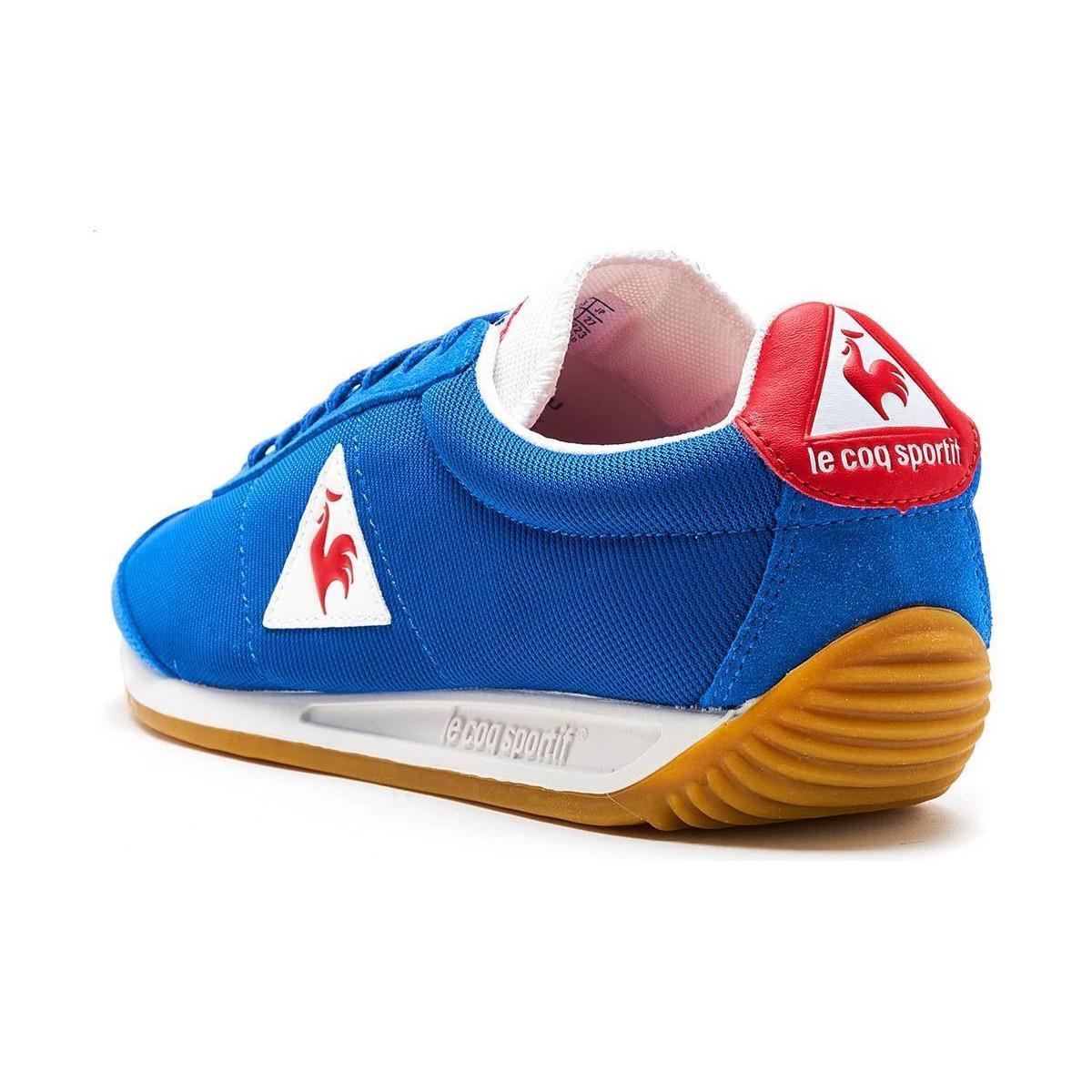 outlet store 01b36 a8285 Le Coq Sportif Quartz Nylon Gum Trainers In Classic Blue Vintage Red ...