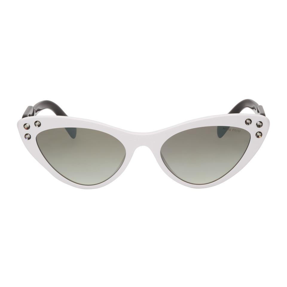 0afdfdc4e79 Miu Miu. Women s White Logomania Cat-eye Sunglasses