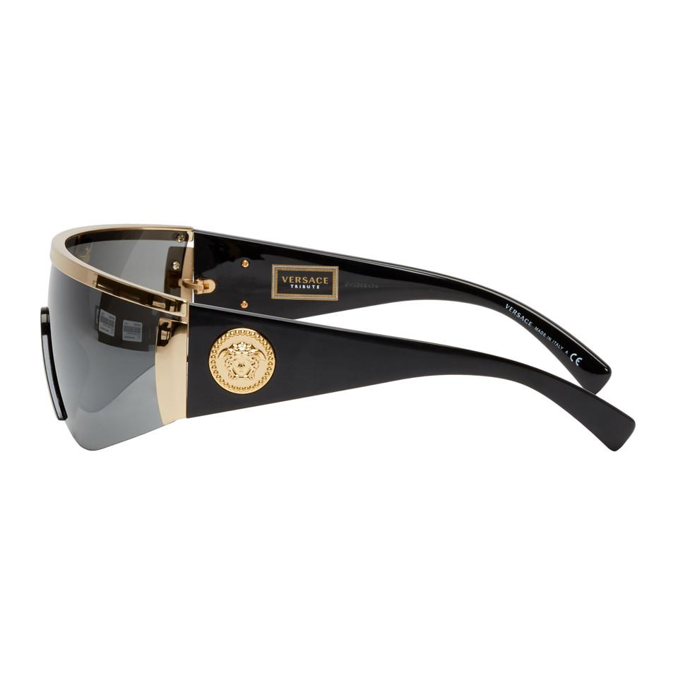 Versace Black And Gold Oversized Metal Shield Sunglasses in Metallic