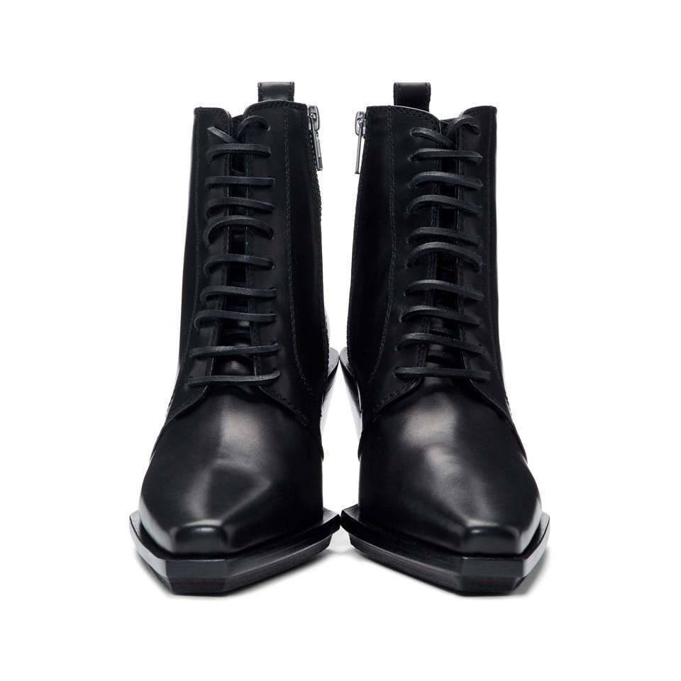 Bottes lacees a talons compenses noires Cuir Ann Demeulemeester en coloris Noir