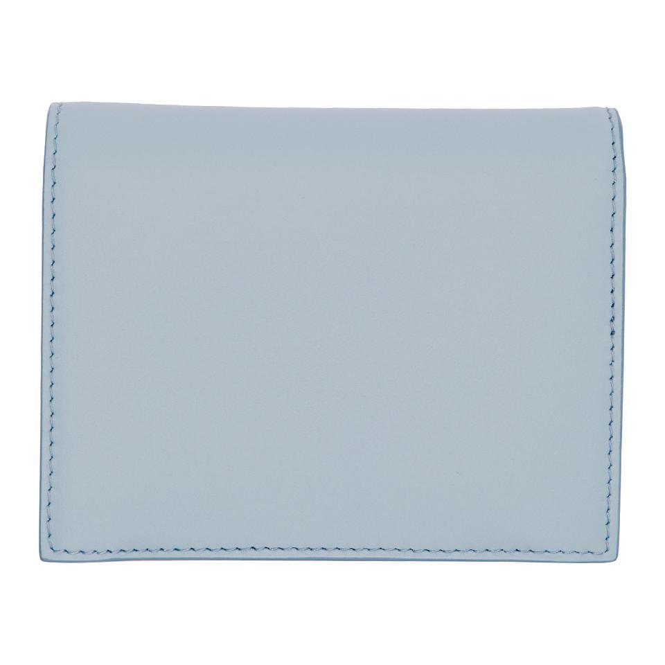 5ea496549faf Miu Miu - Blue Bow Bifold Wallet - Lyst. View fullscreen
