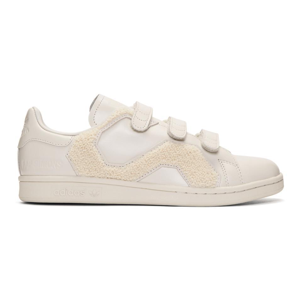 low priced e8afa 64a8e raf-simons--Baskets-blanc-casse-Stan-Smith-Comfort-Badge-edition-adidas- Originals.jpeg