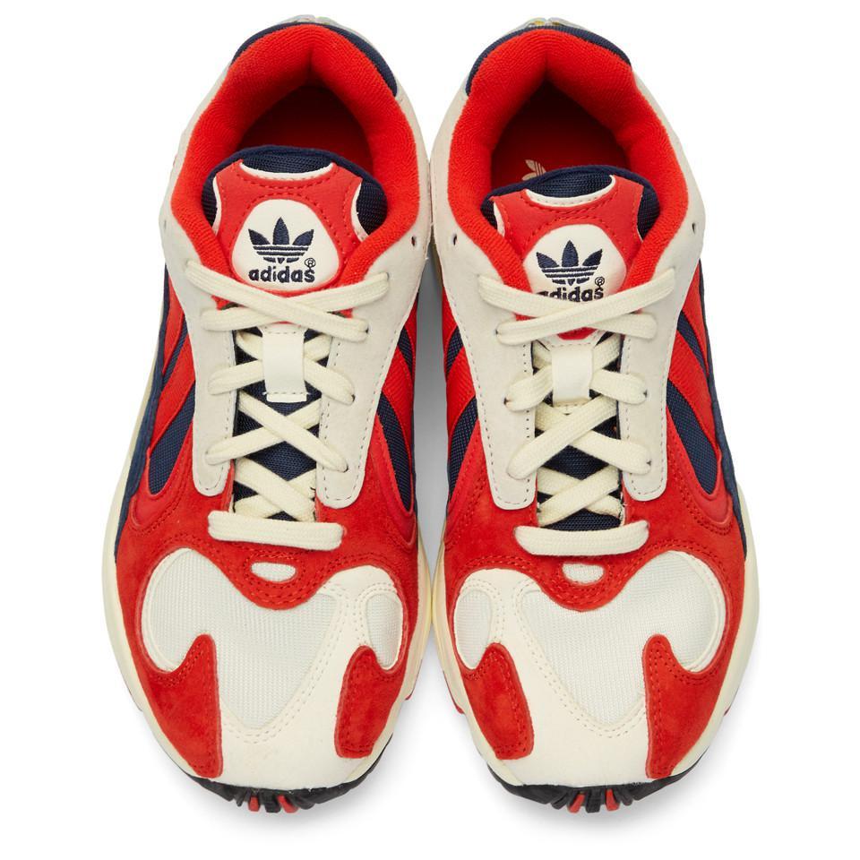 magasin britannique esthétique de luxe qualité supérieure Baskets blanches et rouges Yung 1 Daim adidas Originals en ...
