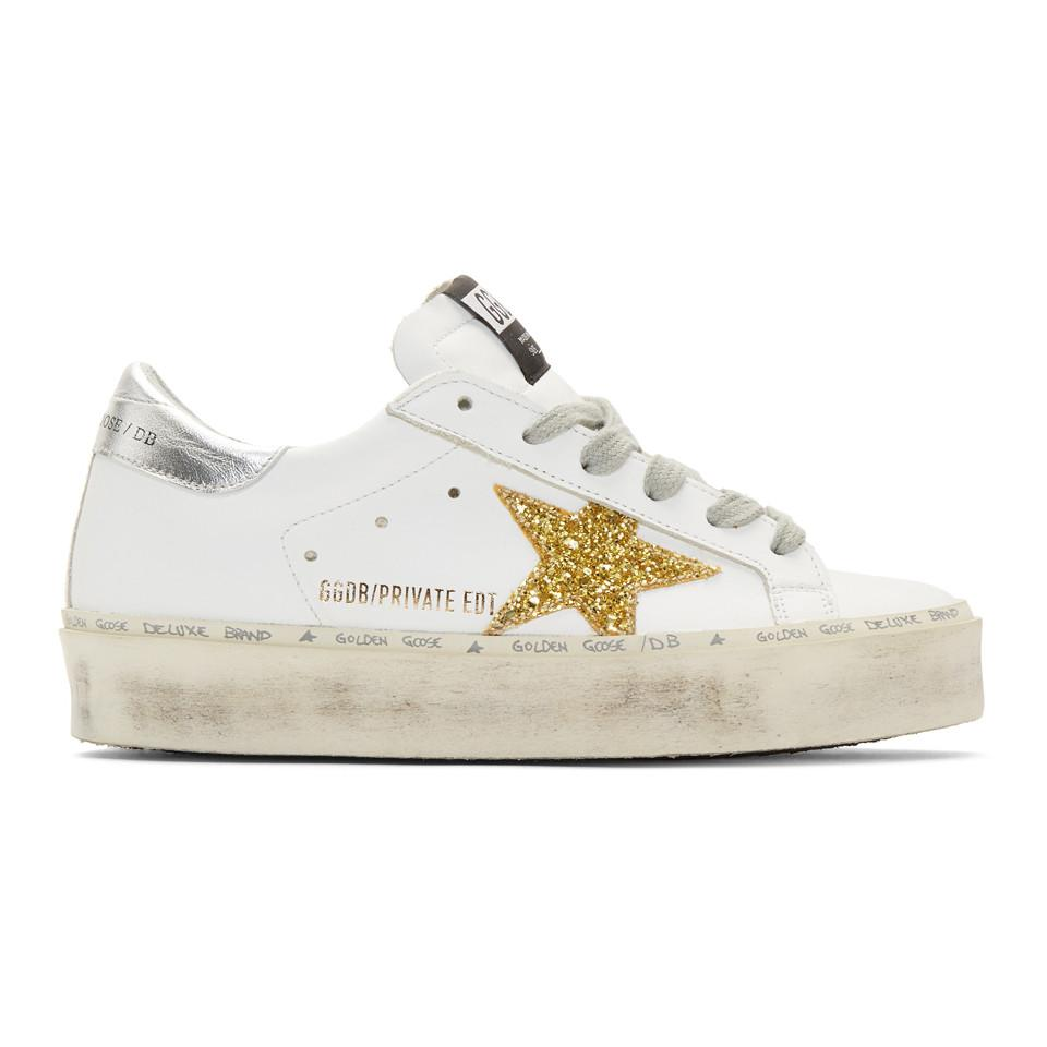 dda2f023b28a Golden Goose Deluxe Brand. Women s Ssense Exclusive White And Gold Glitter  Hi-star Trainers