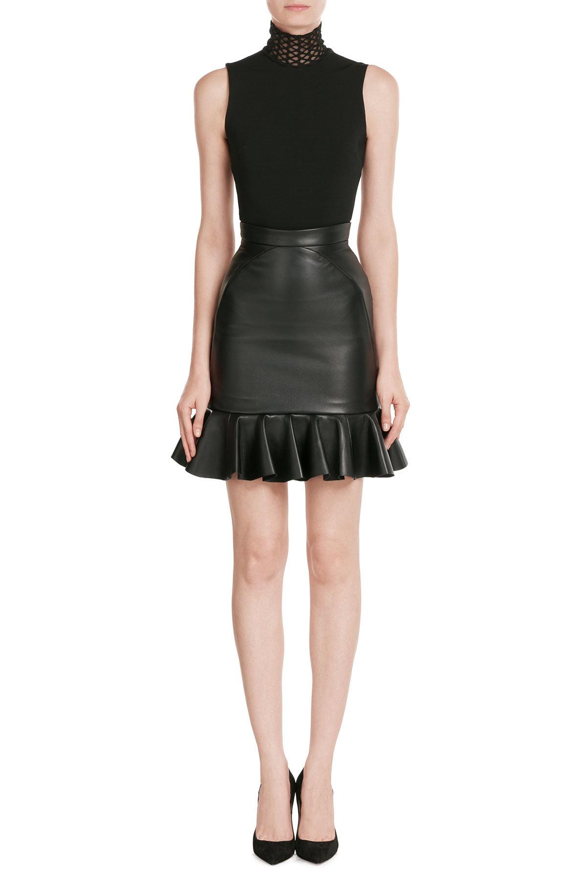 Ruffle Front Faux Leather Skirt: You'll be the center of attention in this faux leather skirt, with its fun asymmetrical ruffle detail at the hem. Foldover waistband with a back zip closure. Foldover waistband with a back zip closure.