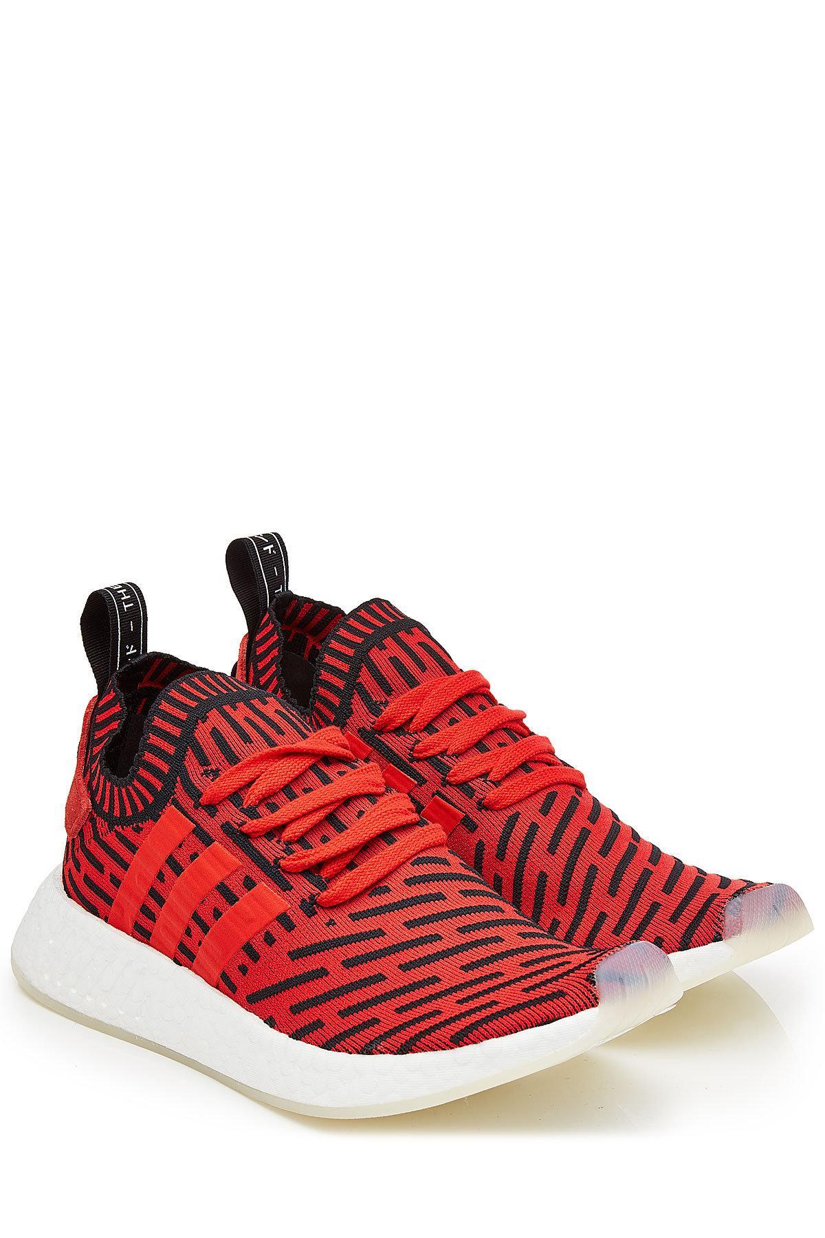 Adidas Originals NMD R2 primeknit zapatilla en rojo para hombres Lyst