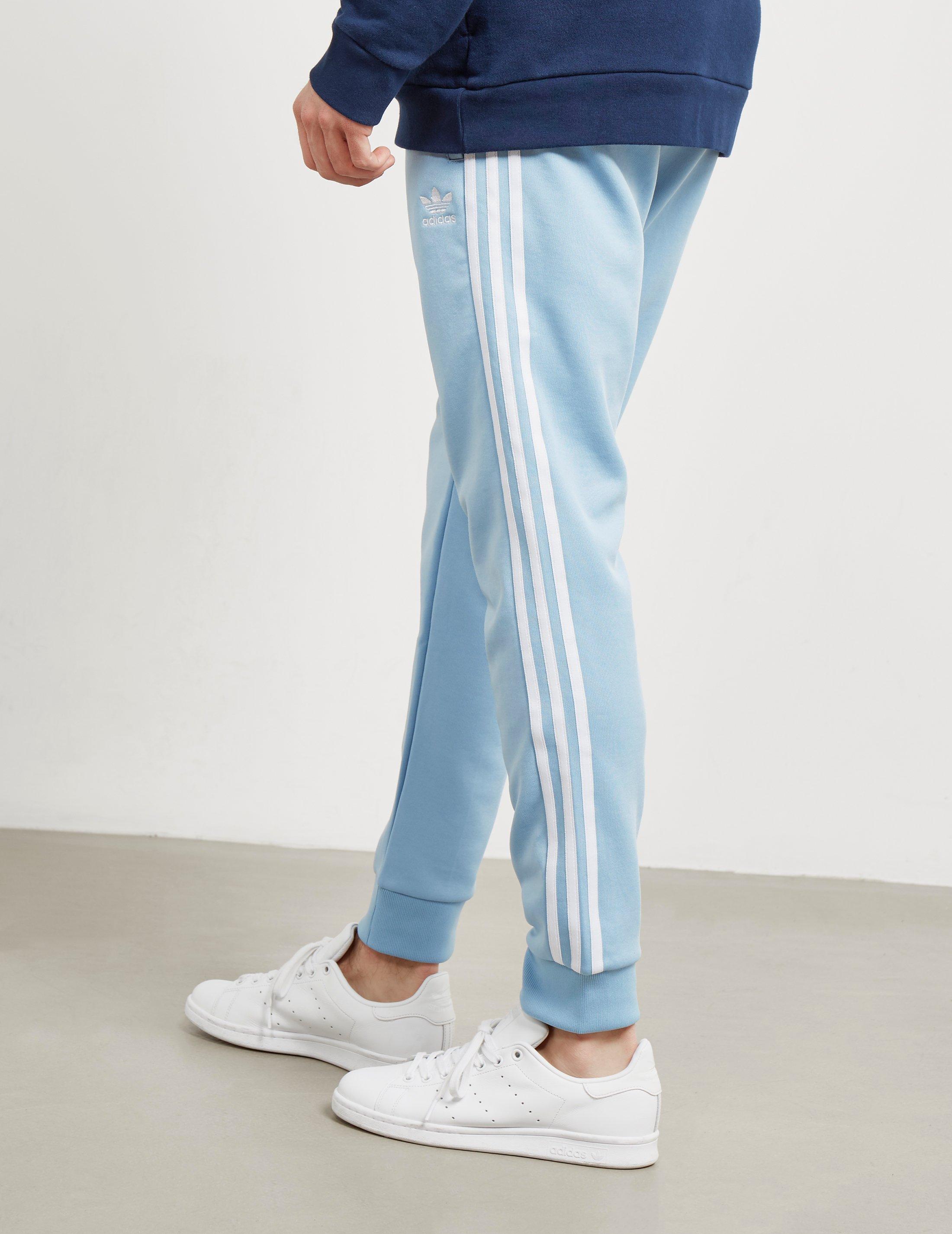 size 40 dc67b 538e5 Adidas Originals Superstar track pants hombre ceniza azul en azul para los  hombres