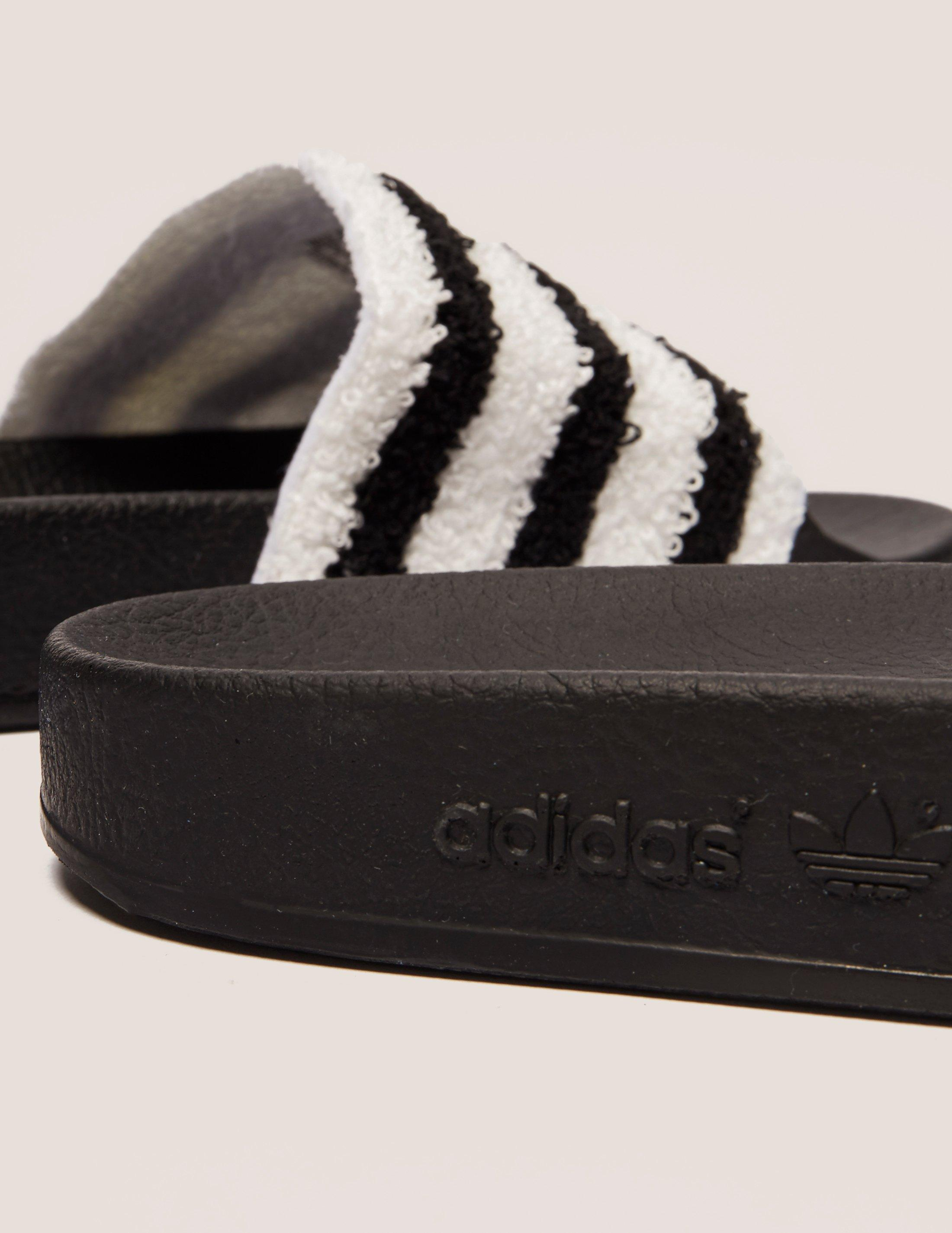 new product df2dd d4b9c adidas Originals Adilette Towel Slides in Black for Men - Lyst