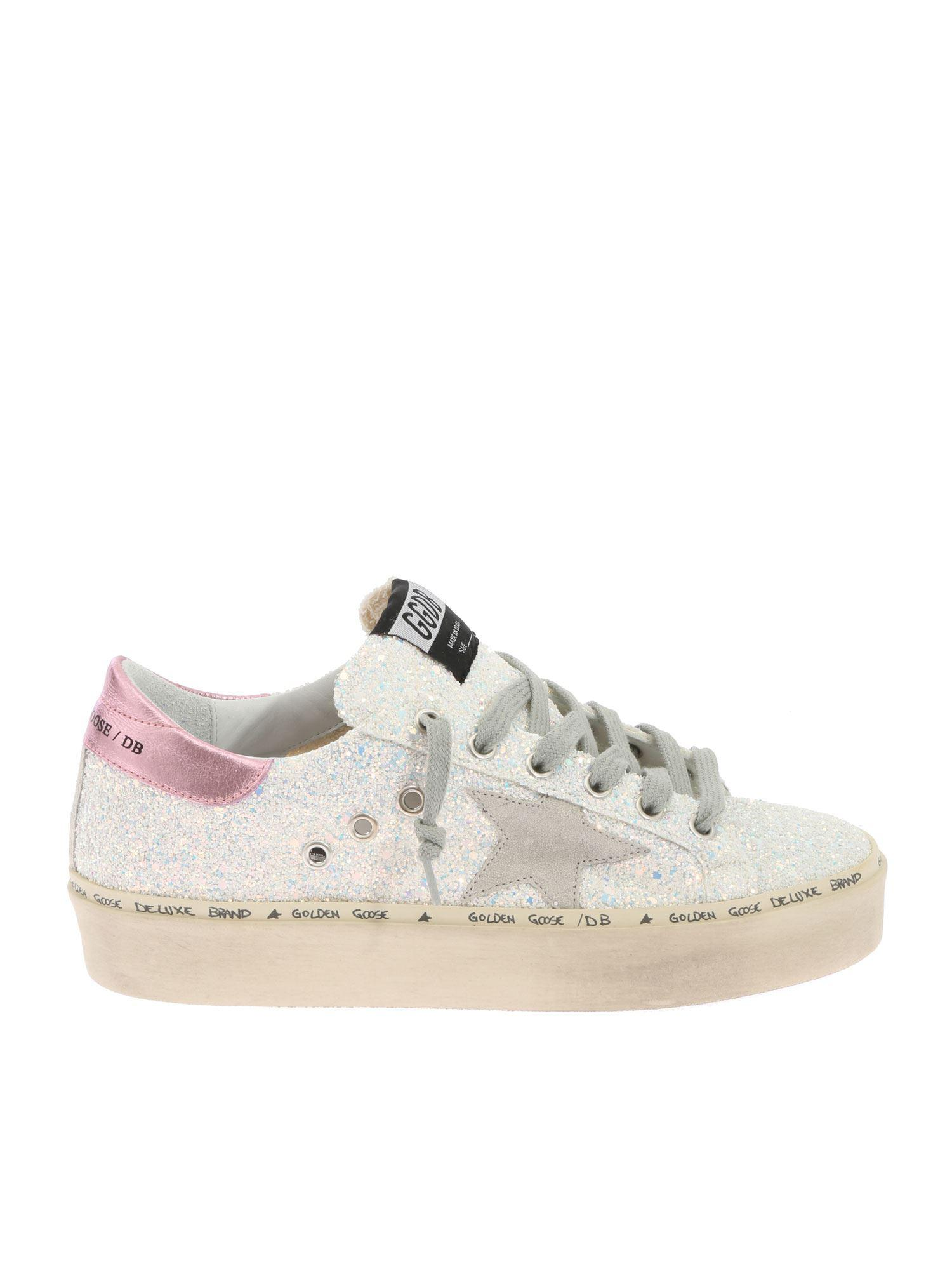 673ca086042d Golden Goose Deluxe Brand. Women s White Ice Star Sneakers With Glitter