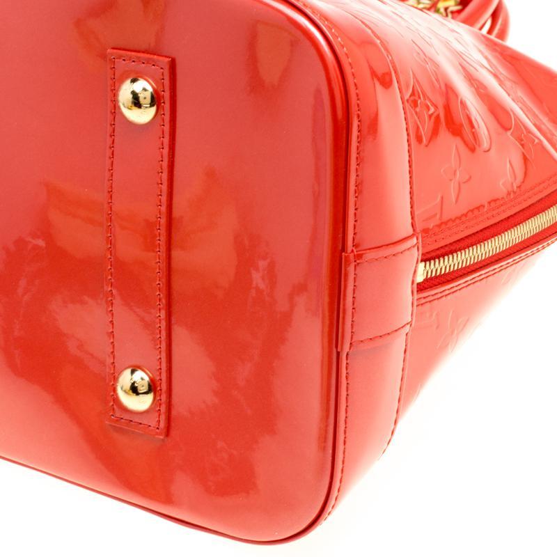 4706eb4985b1 Louis Vuitton Orange Sunset Monogram Vernis Alma Gm Bag With Charm ...