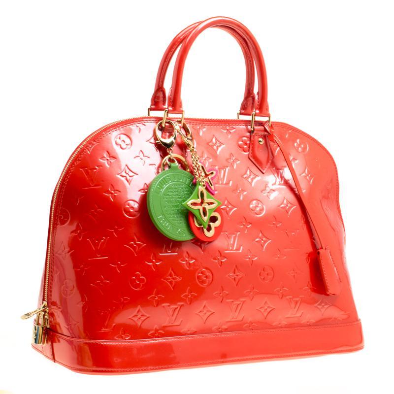 e4777bb0efda Lyst - Louis Vuitton Orange Sunset Monogram Vernis Alma Gm Bag With ...