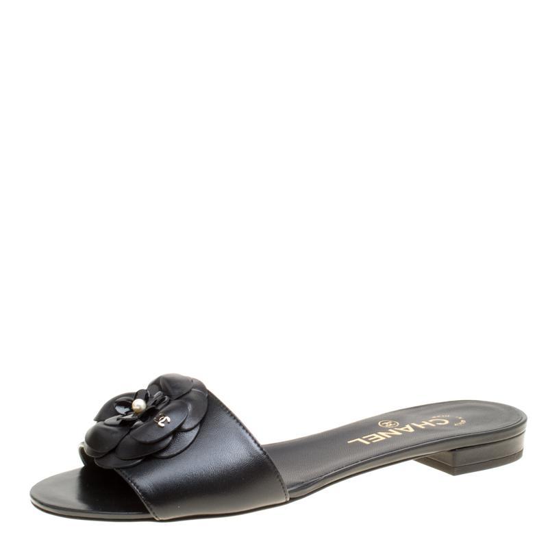 e50f3e4ba7d9 Lyst - Chanel Leather Camellia Embellished Flat Slides in Black