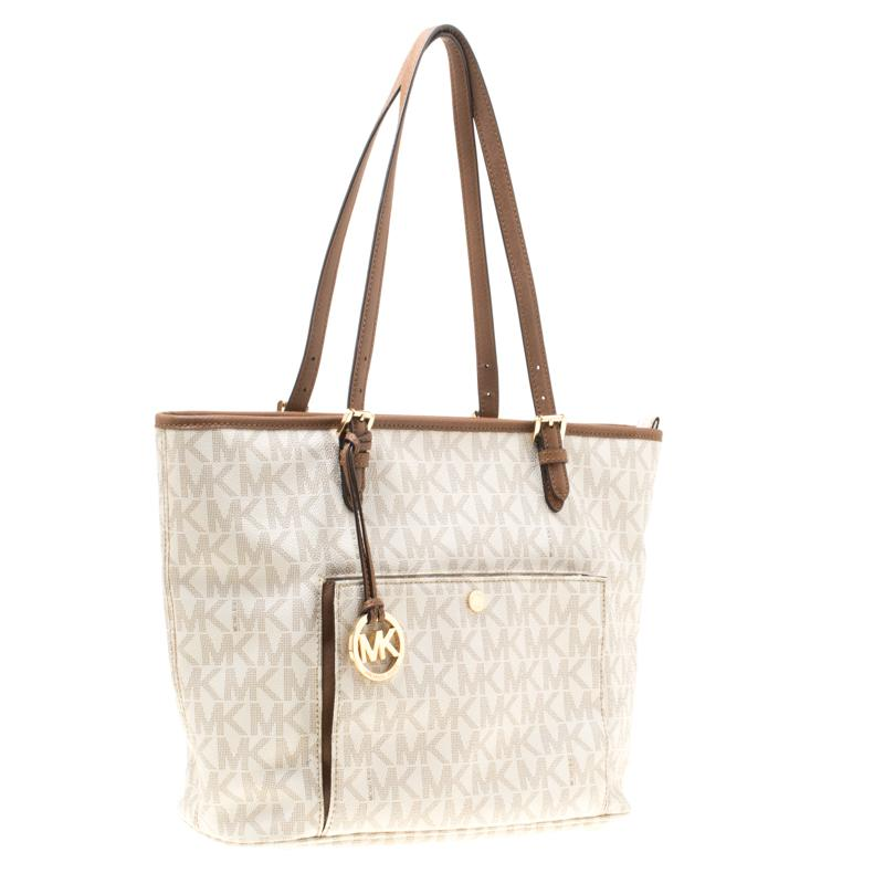 5610844d0 Lyst - MICHAEL Michael Kors White Signature Coated Canvas Jet Set ...