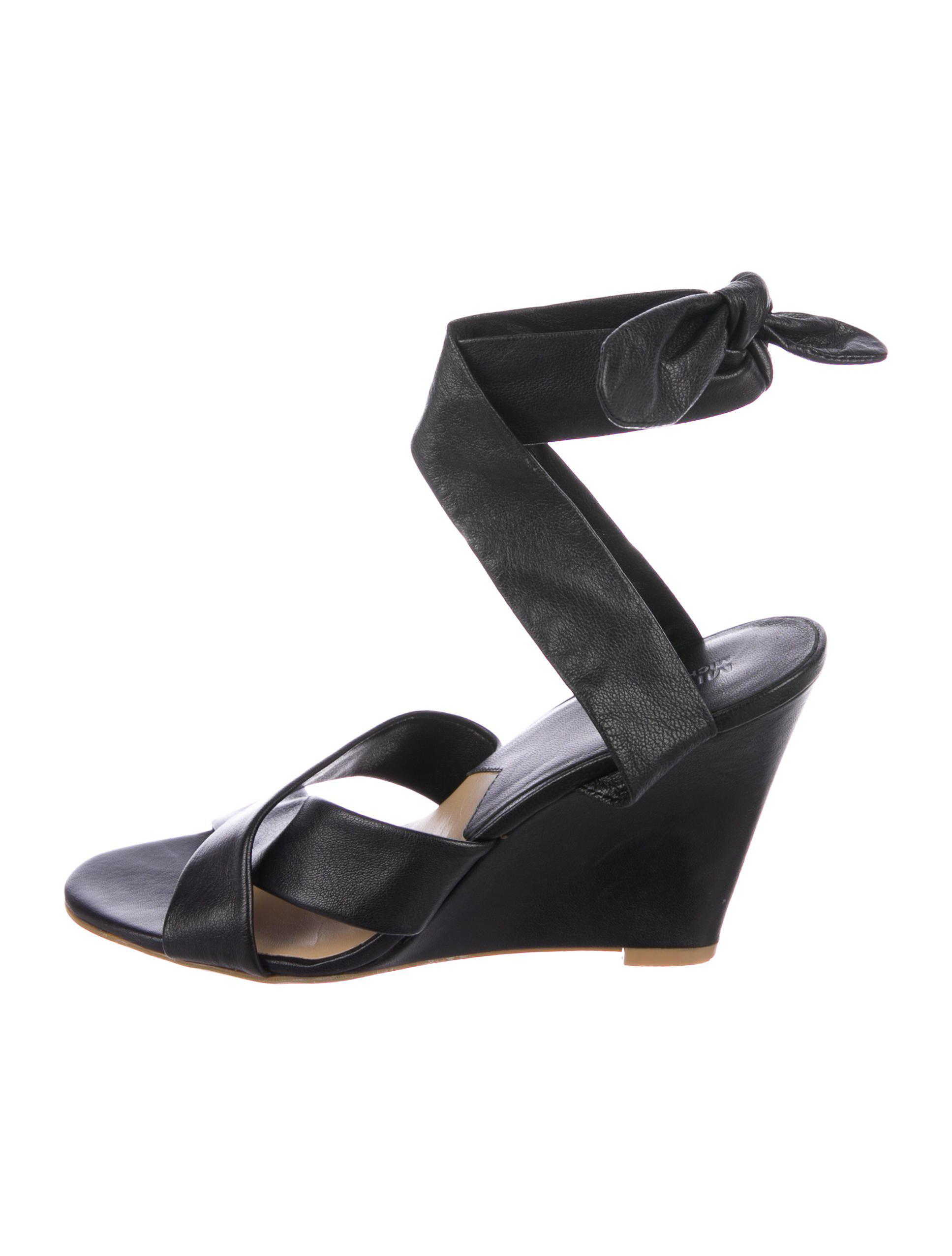 0df6775ce47f Lyst - Michael Michael Kors Michael Kors Leather Wedge Sandals in Black