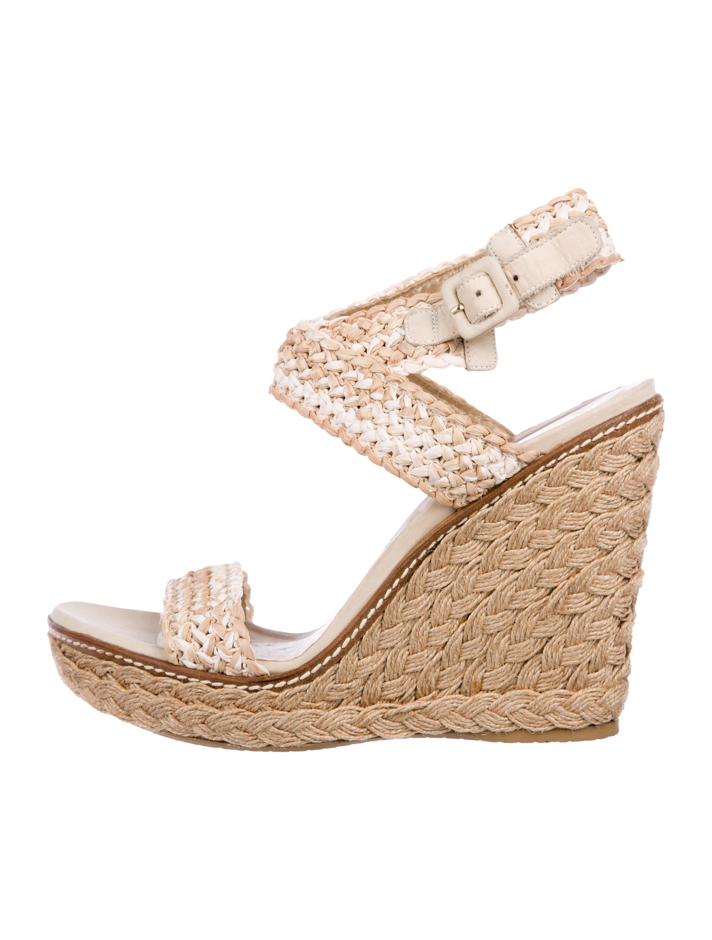 9188954a222e Lyst - Stuart Weitzman Woven Straw Wedge Sandals Tan in Natural