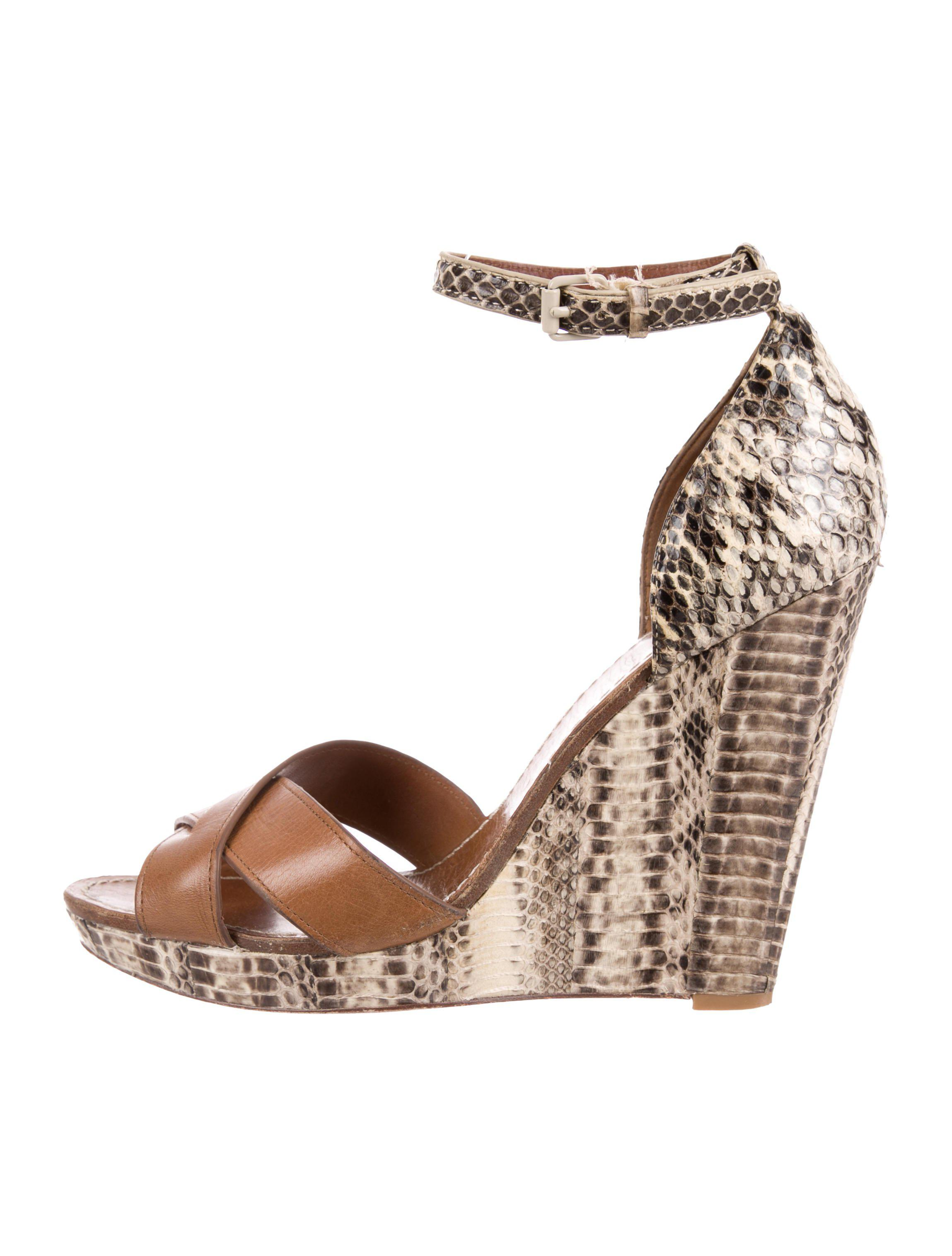 a2c4b874885a Lyst - Tory Burch Embossed Wedge Sandals in Brown