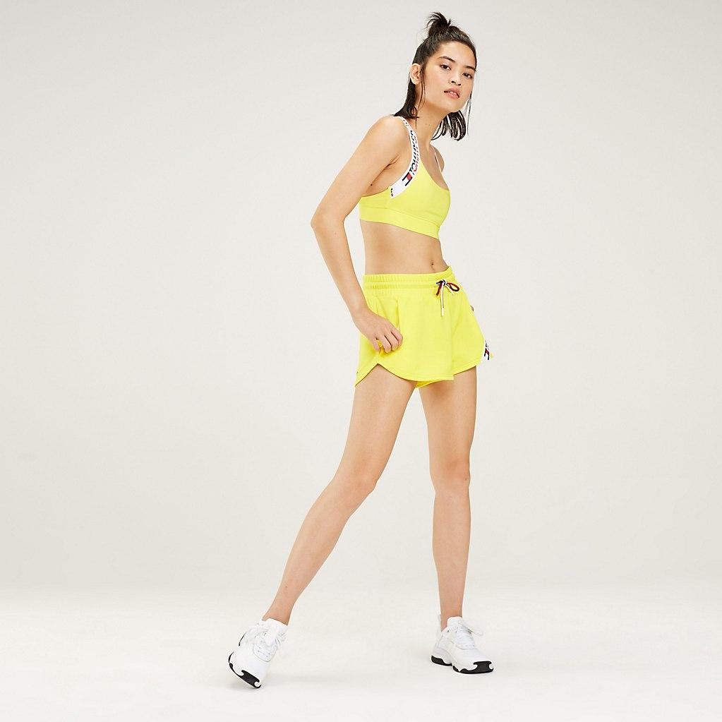 df52548ad6 Tommy Hilfiger Crossover Straps Medium Support Sports Bra in Yellow ...