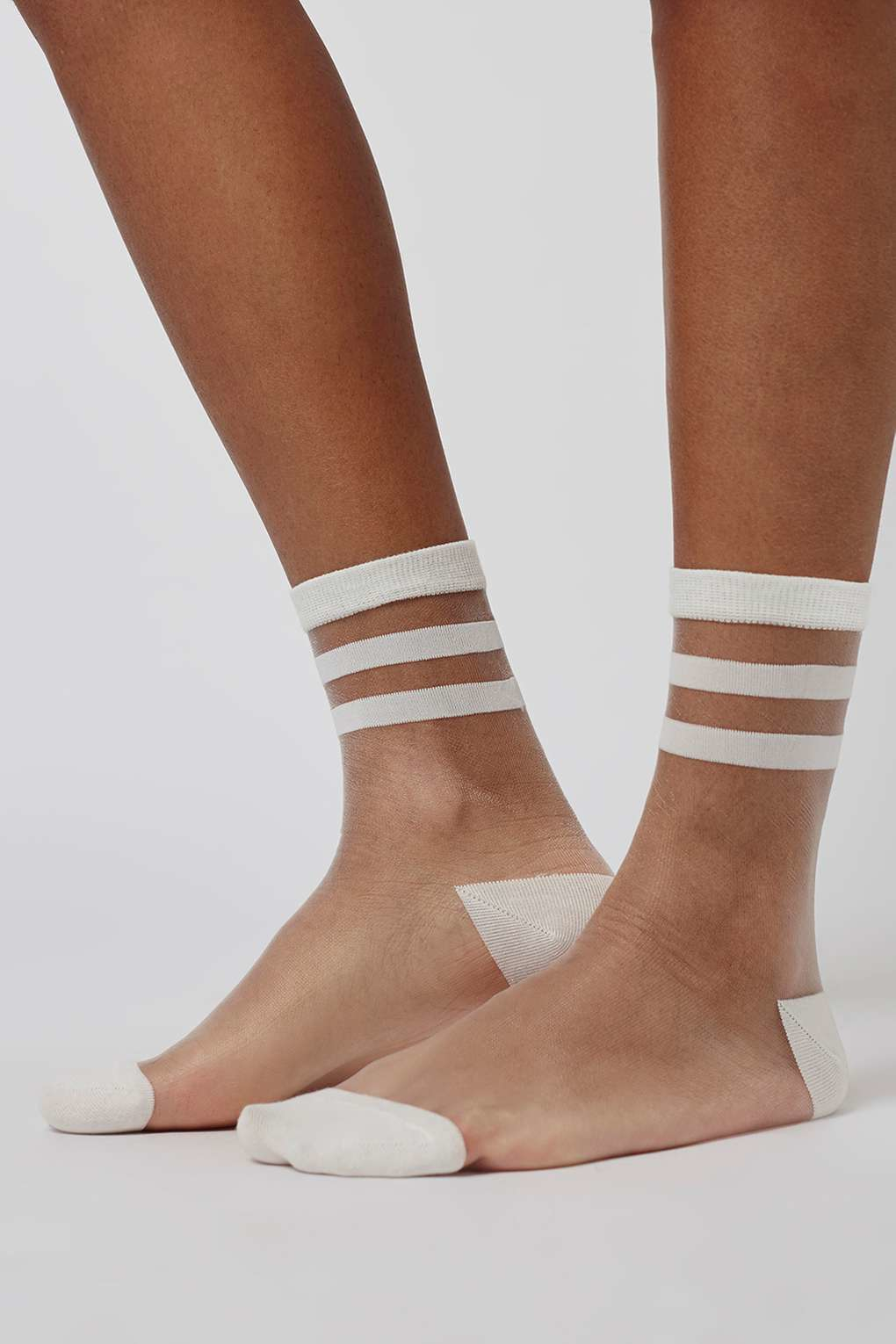 Sheer white, knee high nylon stockings. HEY BABES! SIGNUP TO OUR EXCLUSIVE E-MAIL LIST AND GET 10% OFF YOUR FIRST ORDER.
