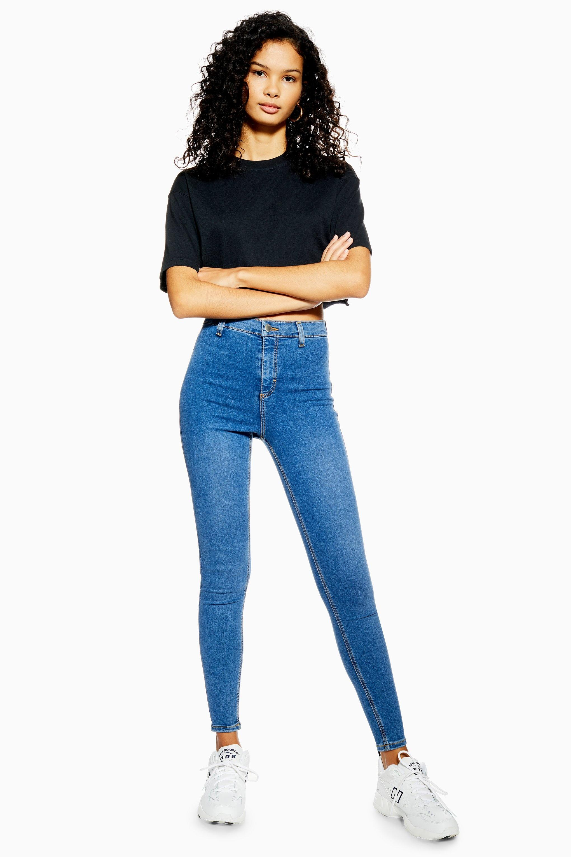 f765c0a0227 Lyst - TOPSHOP Mid Blue Belt Loop Joni Jeans in Blue