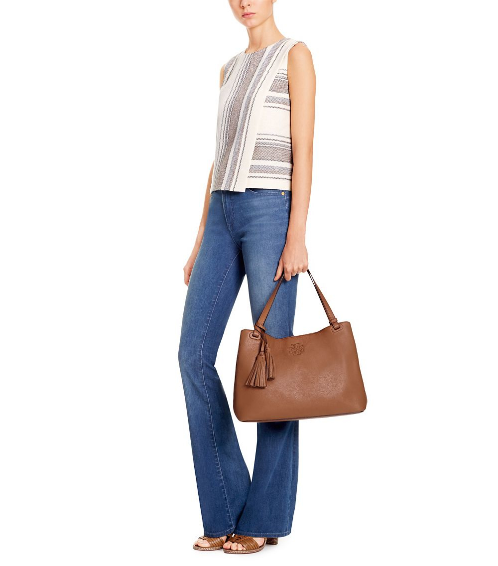 bd9148b761d Tailored meets tassels: a relaxed shape, an embossed logo — finished with  fringe. Our Thea Center-Zip Tote is made of soft pebbled leather and  features ...